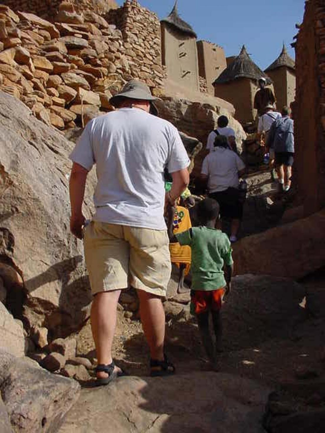 Paul Shumway follows some local children