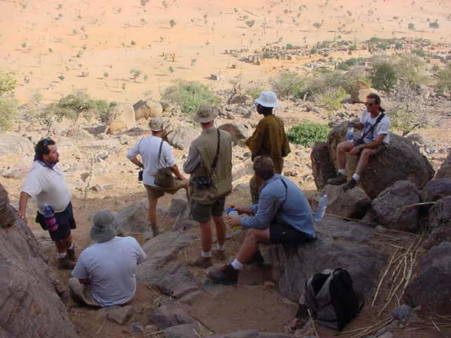 Drive The Globe Expedition team takes a break high above the Dogon Villages below