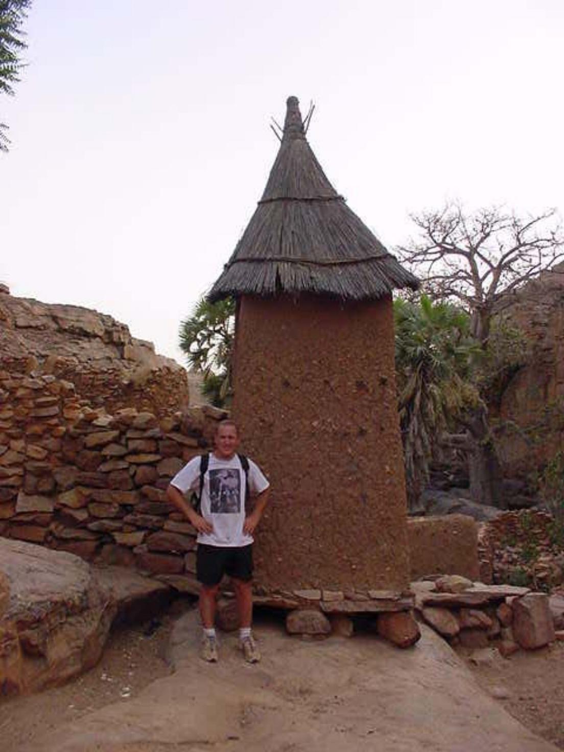 Michael Ladden near a Dogon home