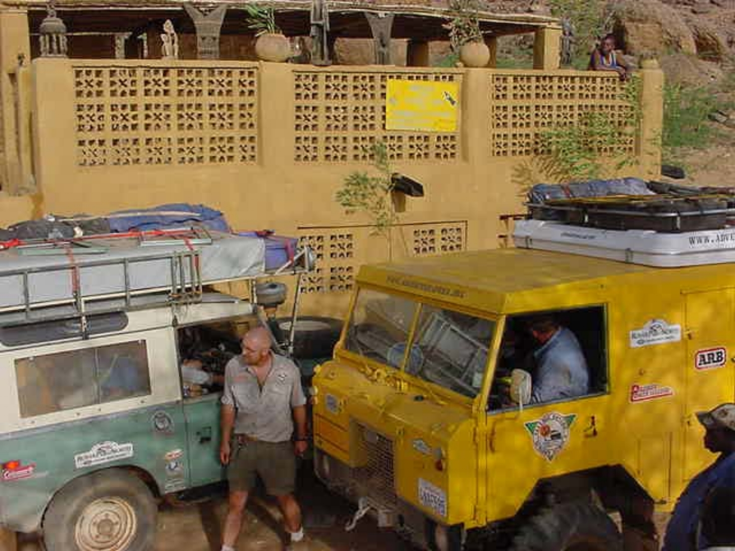 Drive The Globe expedition vehicles arriving in a Dogon village