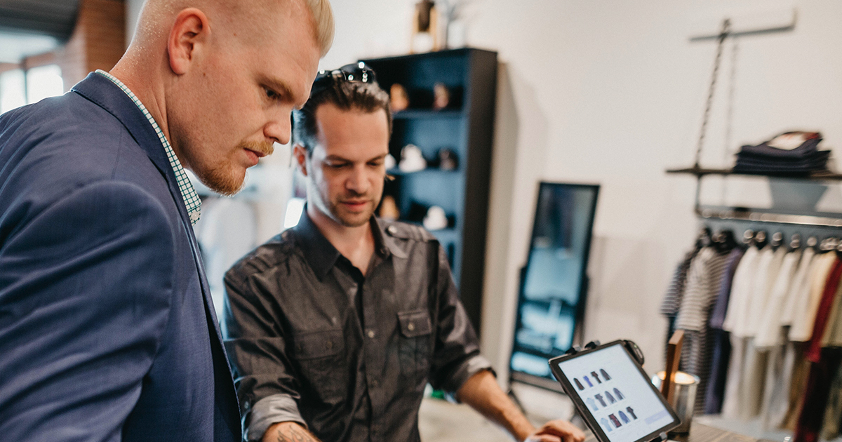 Nuinspiration's Sean Ireton (left), helping a client find the right casual clothes based on Personal Branding materials developed specifically for him. Photography by  Stephanie Portugal at  Alexander Robert Trading Co .