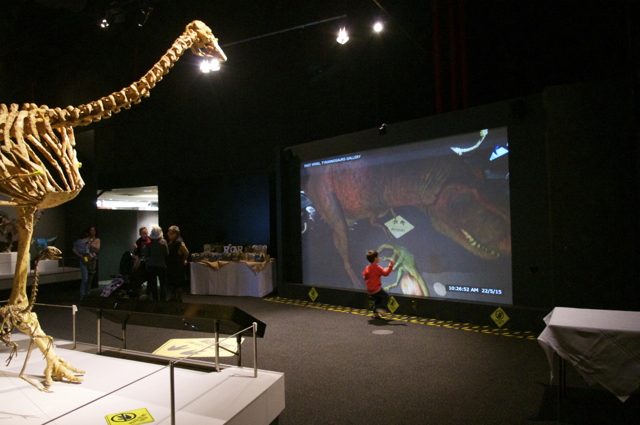 The augmented reality screen for little ones to interact with dinosaurs on the screen. Photo by m4bubs.