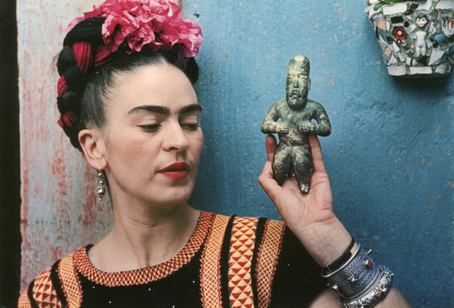 Nickolas Muray - Frida with Olmec figurine, Coyoacan 1939 - colour carbon print - Courtesy of Throckmorton Fine Art, Inc -  © Nickolas Muray Photo Archive - Supplied by Art Gallery of NSW