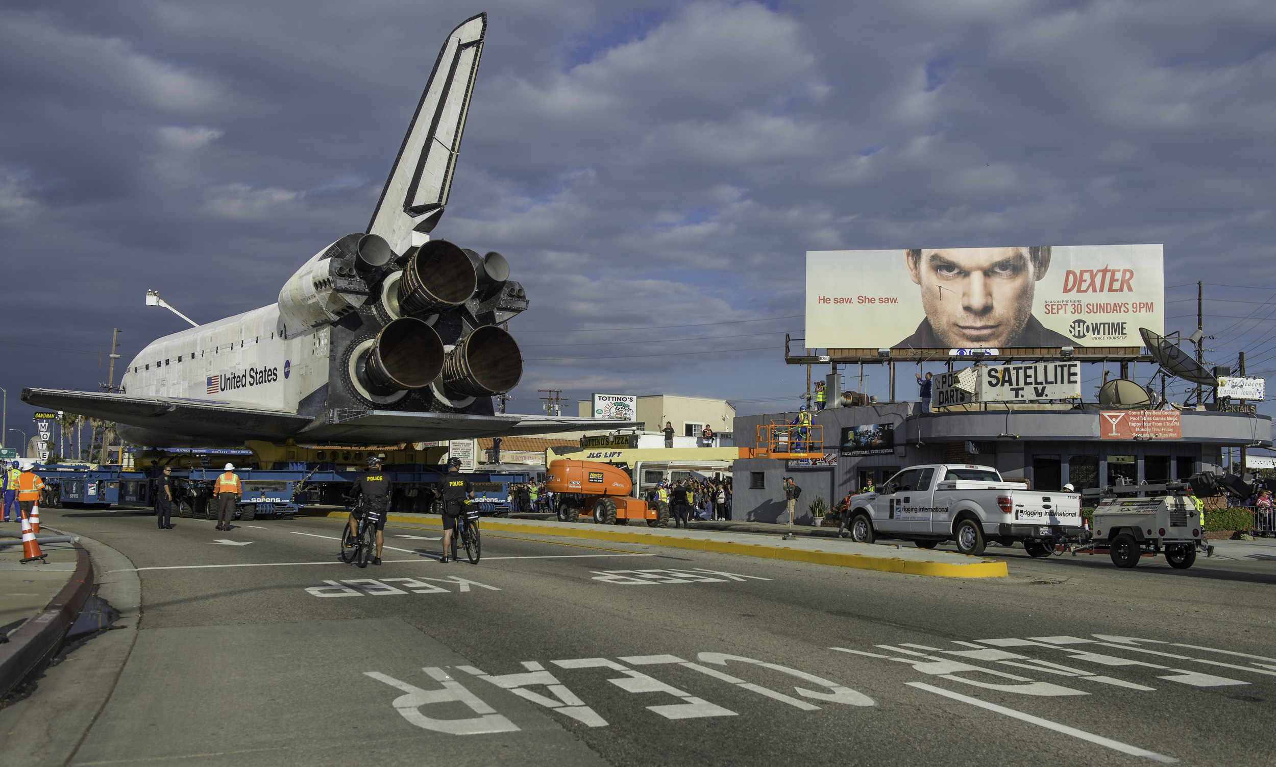 The space shuttle Endeavour is seen as it traverses through Inglewood, California on Friday, Oct. 12, 2012. Endeavour, built as a replacement for space shuttle Challenger, completed 25 missions, spent 299 days in orbit, and orbited Earth 4,671 times while traveling 122,883,151 miles. Beginning Oct. 30, the shuttle will be on display in the CSC's Samuel Oschin Space Shuttle Endeavour Display Pavilion, embarking on its new mission to commemorate past achievements in space and educate and inspire future generations of explorers. (NASA/Carla Cioffi)
