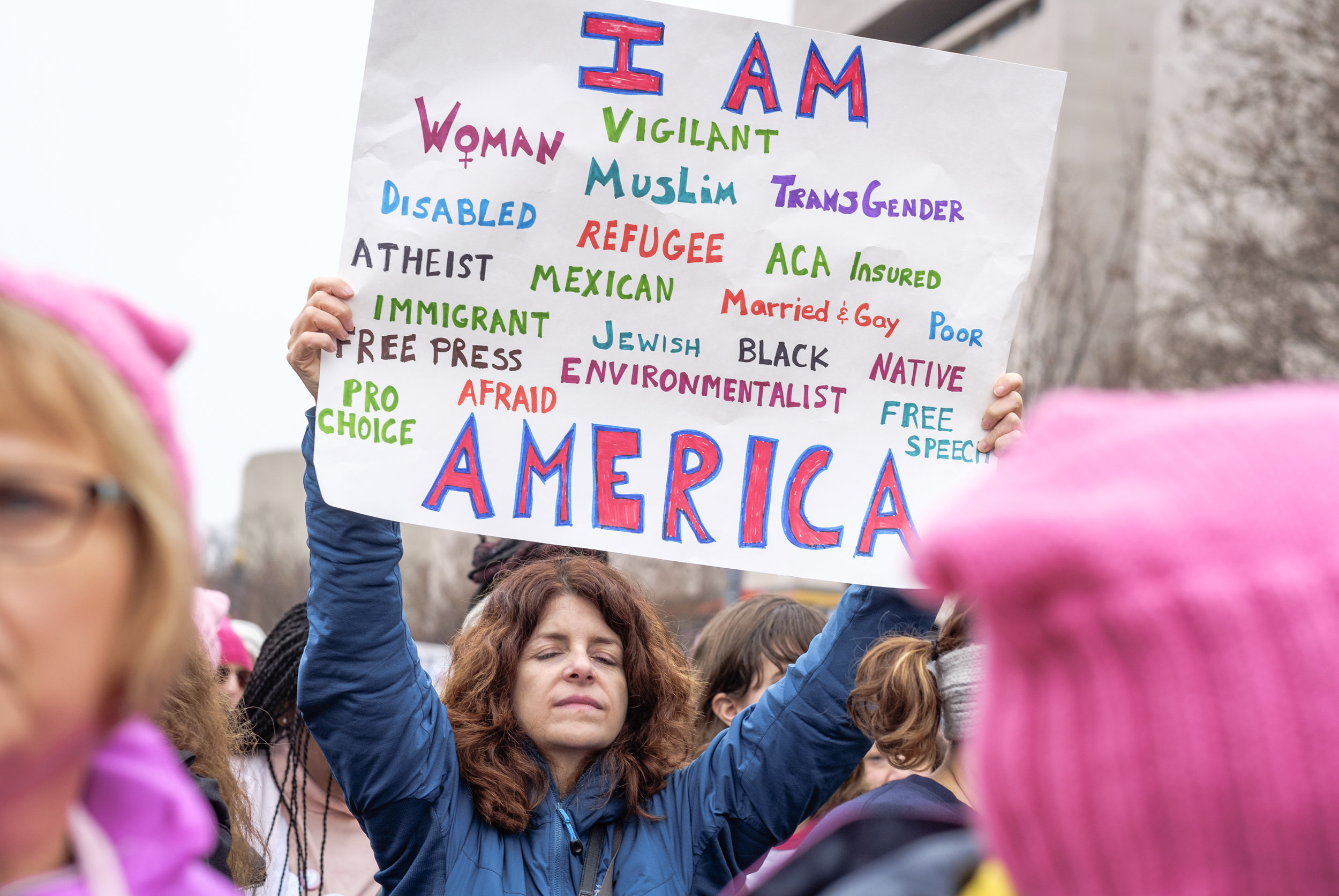 "A woman is seen holding a homemade poster at the first-ever Women's March on Washington on Saturday, January 21, 2017. It is estimated that over 500,000 marched, and well over 1 million people world-wide. People came together to proclaim unity and to stand firm on the principles of human rights. ""Women's Rights are Human Rights and Human Rights are Women's Rights."""