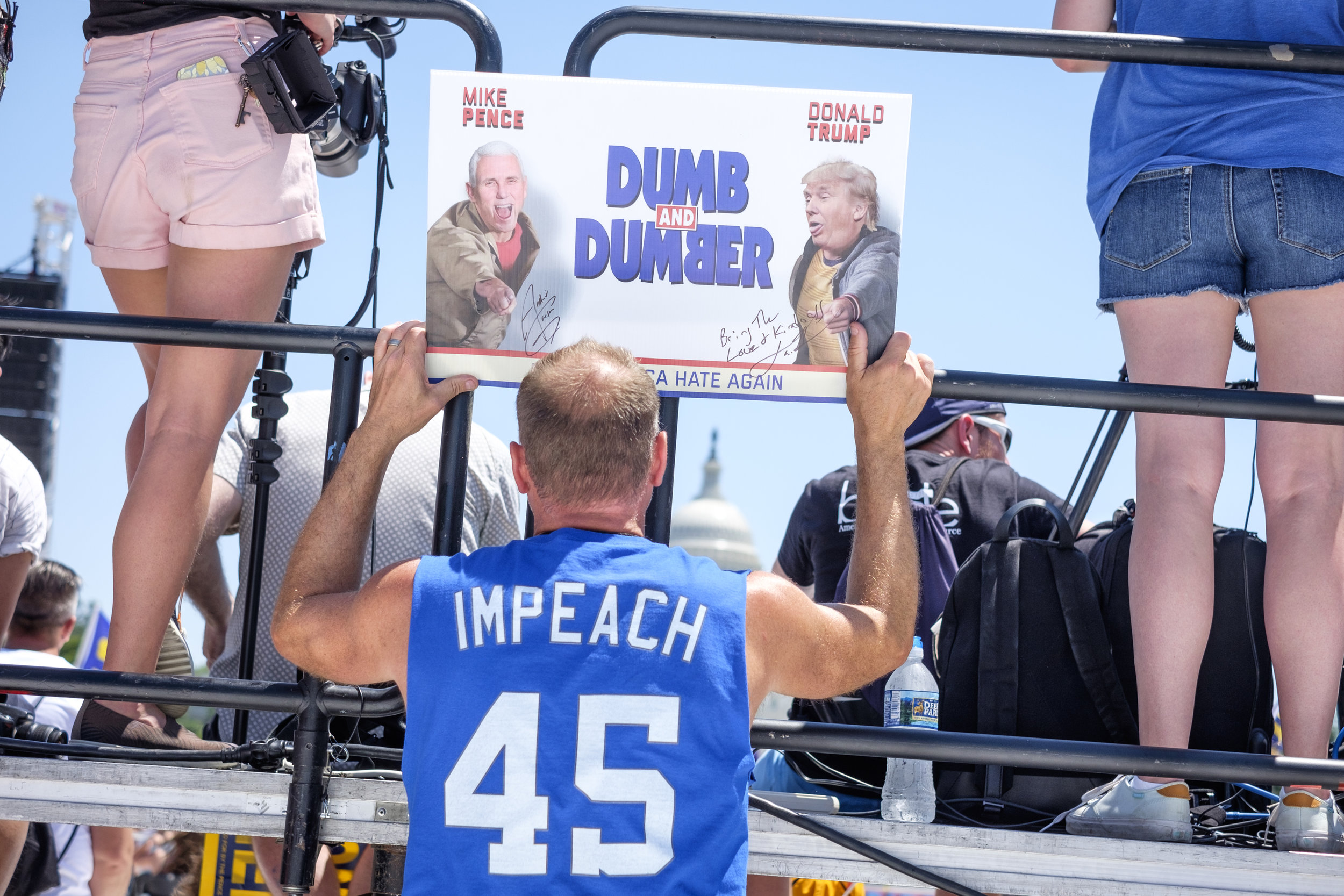"""Kevin Warren of Indianapolis, IN is seen from behind holding his poster as he listens to speakers at the rally following the Equality March for Unity and Pride on Sunday, June 11, 2017 in Washington, DC. I asked him why he attended the march and he replied, """"Well, we're here to obviously march on Washington, and we're representing Indiana. We started a political action committee two years ago called Pence Must Go. This is just part of it and we're bringing it to DC."""""""