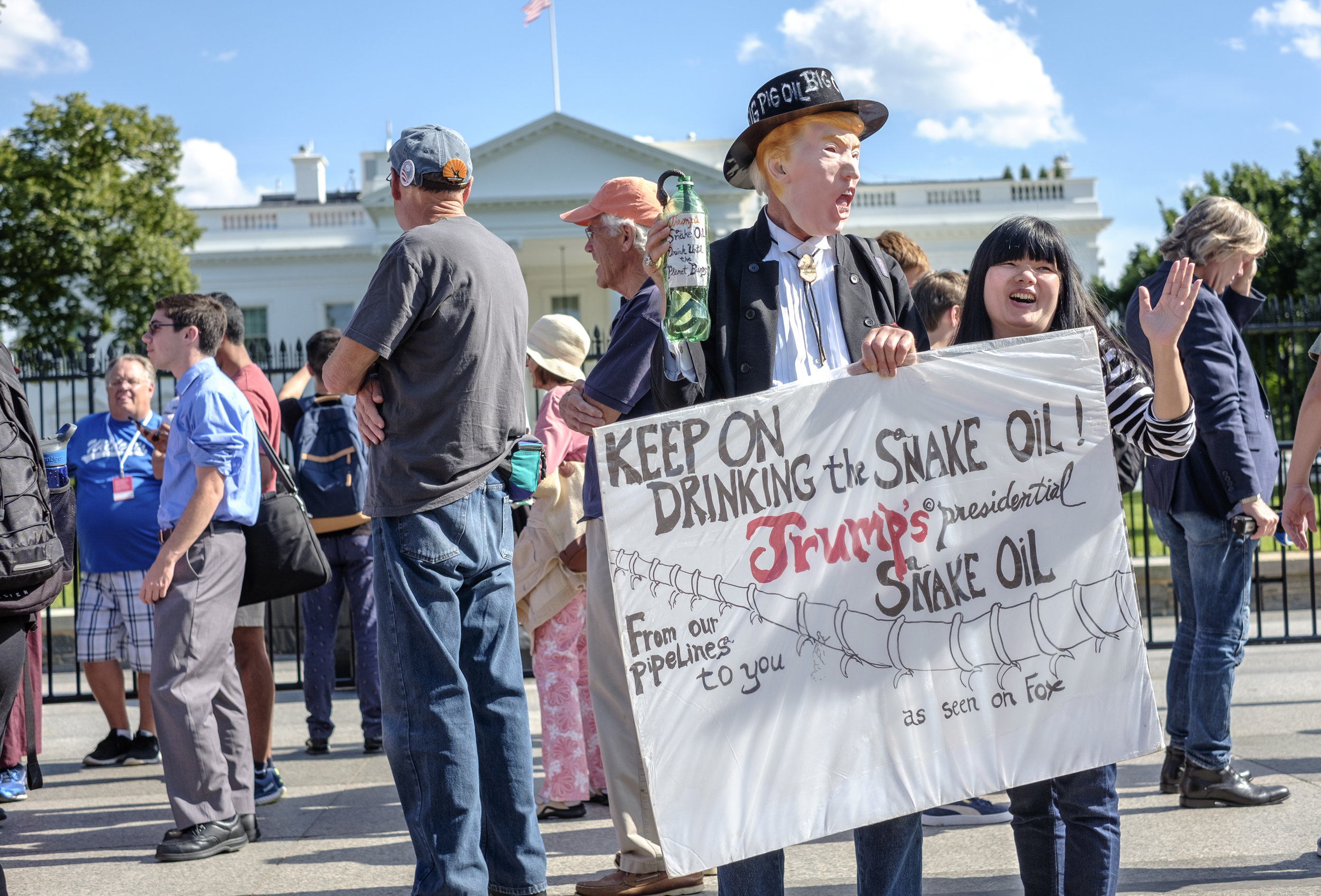"""David Barrows of Washington, DC is seen in front of the White House at an emergency rally wearing a Trump mask on Thursday, June 1, 2017. When asked what he was doing there he said, """"I'm here to try to do what I can to save our planet from their plans of destruction. There's no way the planet is going to survive all this greed and war, all these bombs falling, all this exploitation of tar sands, all the ruination of Indian lands and all the rest of it. So it's up to the people to stand up to tyrannical government. We have a better chance here than anybody else, so we need to do it.""""  Two hours after Trump announced the US withdrawal from the Paris Agreement on Climate Change, people gathered at the White House for an emergency rally to protest this decision. The Paris Agreement was signed by 196 countries. The US, along with Nicaragua and Syria, did not sign. Climate change is considered by many the planets' biggest issue with frontline communities being the most affected. Frontline communities are the poor, communities of color and Indigenous people."""