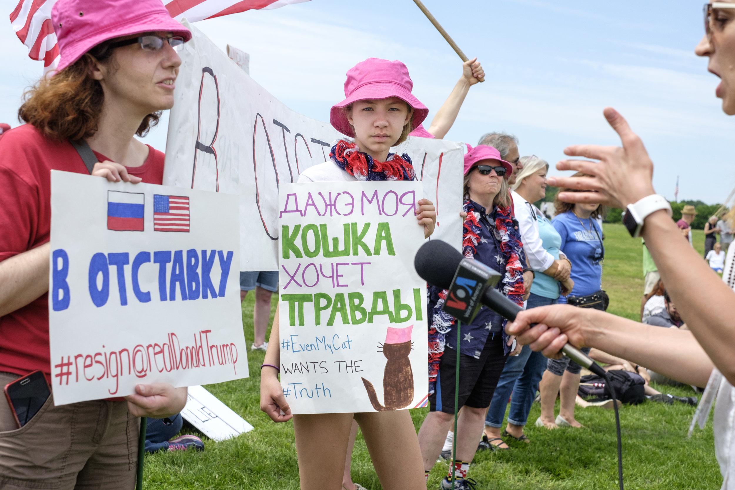 """Maddie Smith of Maryland, center, is seen at the March for Truth DC rally held on the National Mall on Saturday, June 3, 2017 in Washington, DC. When asked why she attended the protest she said simply, """"I'm pro-Truth."""" Her sign, written in both Russian and English, states """"Even My Cat Wants the Truth."""""""