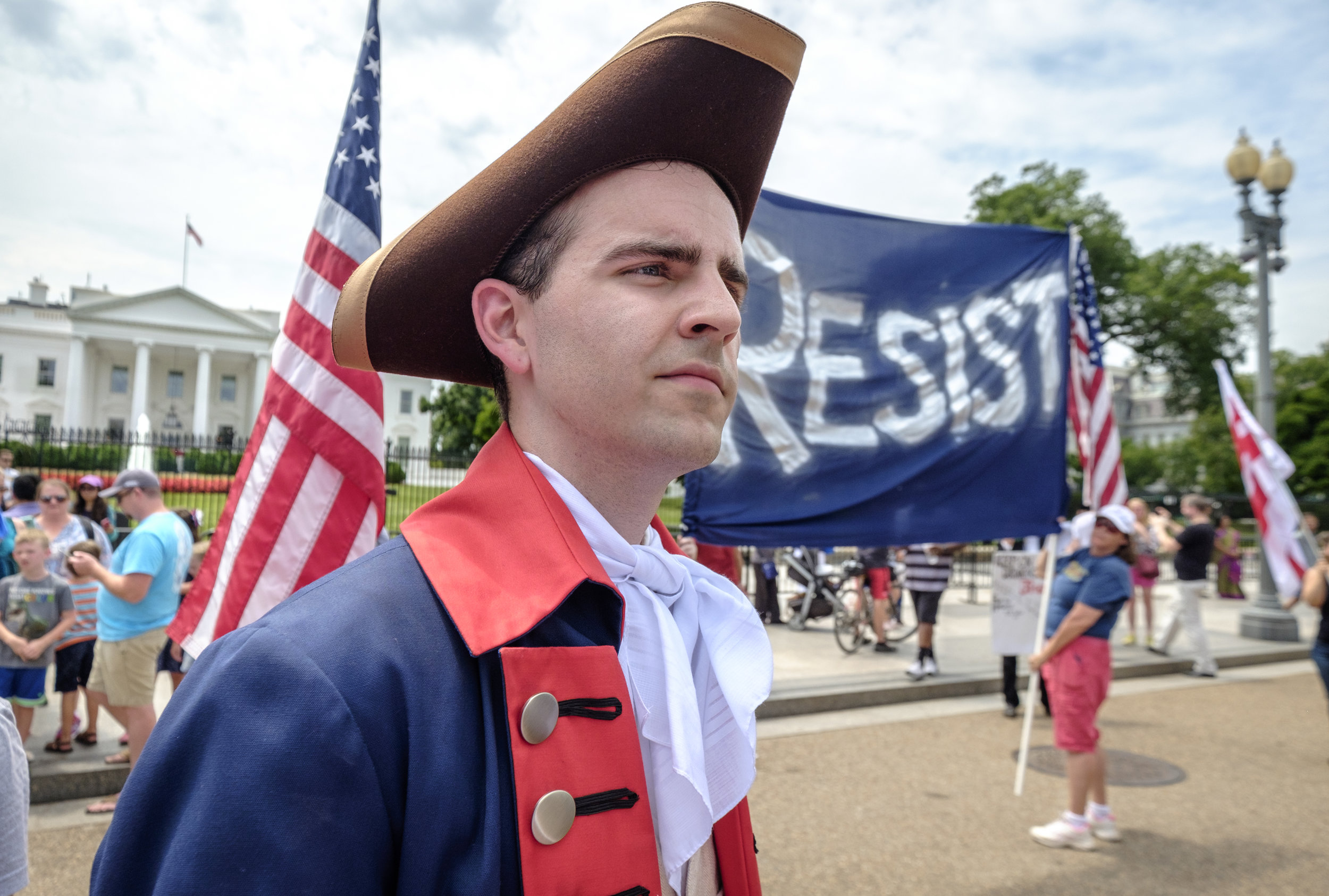 "Ross, of the Washington, DC area, is seen at the July 4th White House Flash Mob in front of the White House on Tuesday, July 4, 2017. He had the following to share when asked why he took part in this event, ""I feel very strongly about the presidency being degraded by Donald Trump. He's putting not just any political party, affiliation, or any particular group of people at risk, but he is, it's everyone. All Americans should be concerned about the way things are headed. Just the un-presidential nature of his administration and… I could go on. You can look up what he's done. Everyone knows. So, yeah, that's why I'm here. And it's Independence Day, so I thought it was an appropriate time to be out here."" Participants in the July 4th Flash Mob sang ""Do You Hear The People Sing"" from Les Miserable as a reminder to Trump that every day the resistance grows stronger, and that the people demand his impeachment."