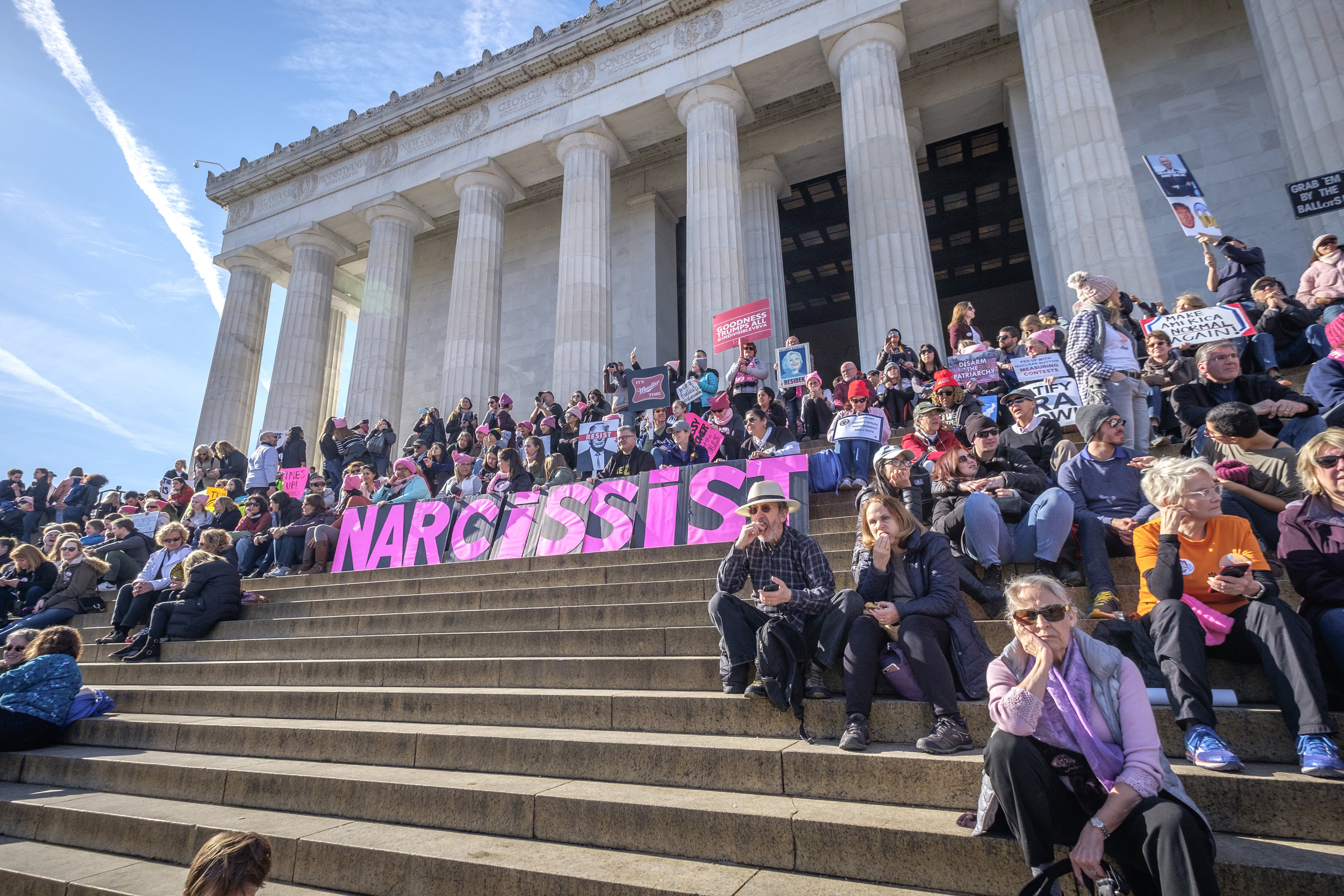 "Protestors present a large ""NARCISSIST"" sign on the steps of the Lincoln Memorial during the anniversary rally of the Women's March on Saturday, January 20, 2018 in Washington, DC. Thousands of people gathered with the goal of advancing peaceful and positive progress in communities across the country, and ensuring all women and their allies persist in civic and political roles moving into 2018. Sister marches took place around the country and around the world."