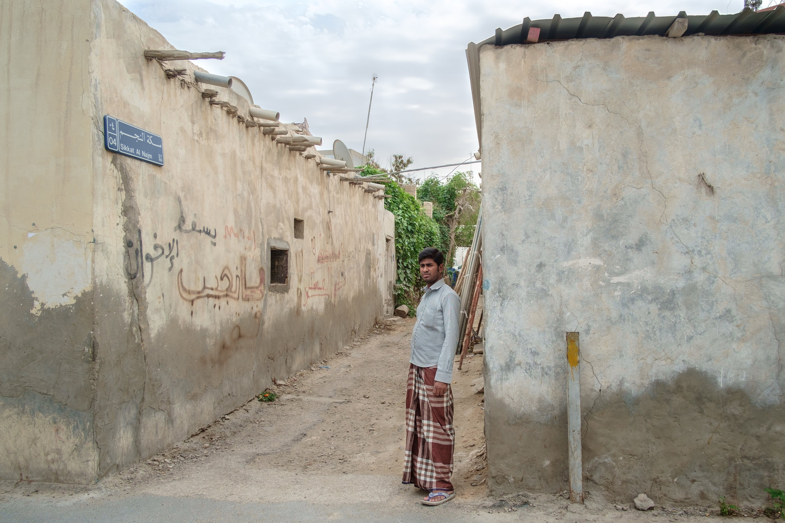 A blue-collar expat is seen in the old Musheireb neighborhood of Doha. Much of this neighborhood has been torn down, and the residents forcibly removed, in order to build the New Msheireb development. Qatar is in a race to revitalize and modernize in time to host the 2022 FIFA World Cup.