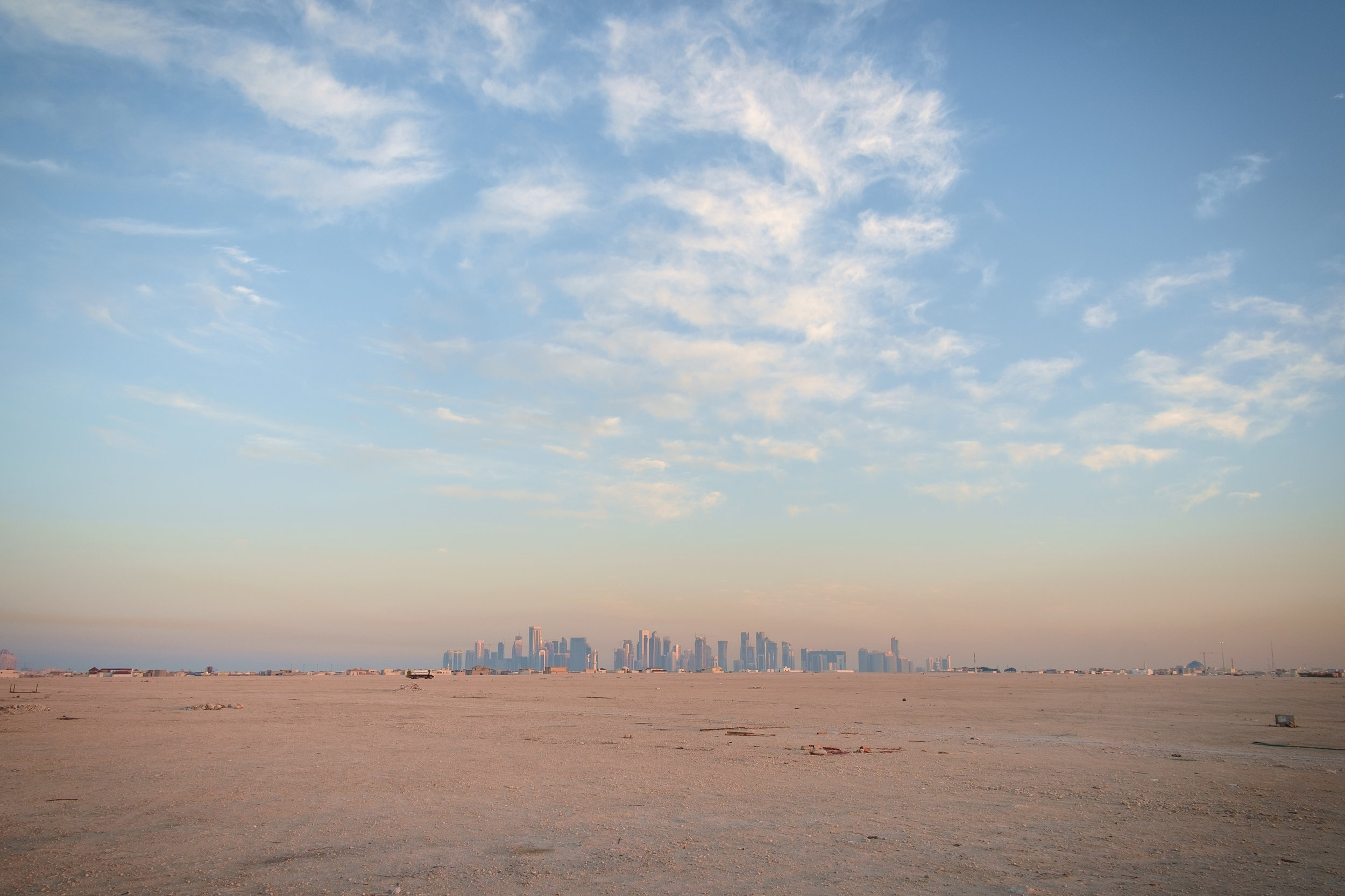 West Bay, Doha's business district and iconic skyline, is seen in the distance.