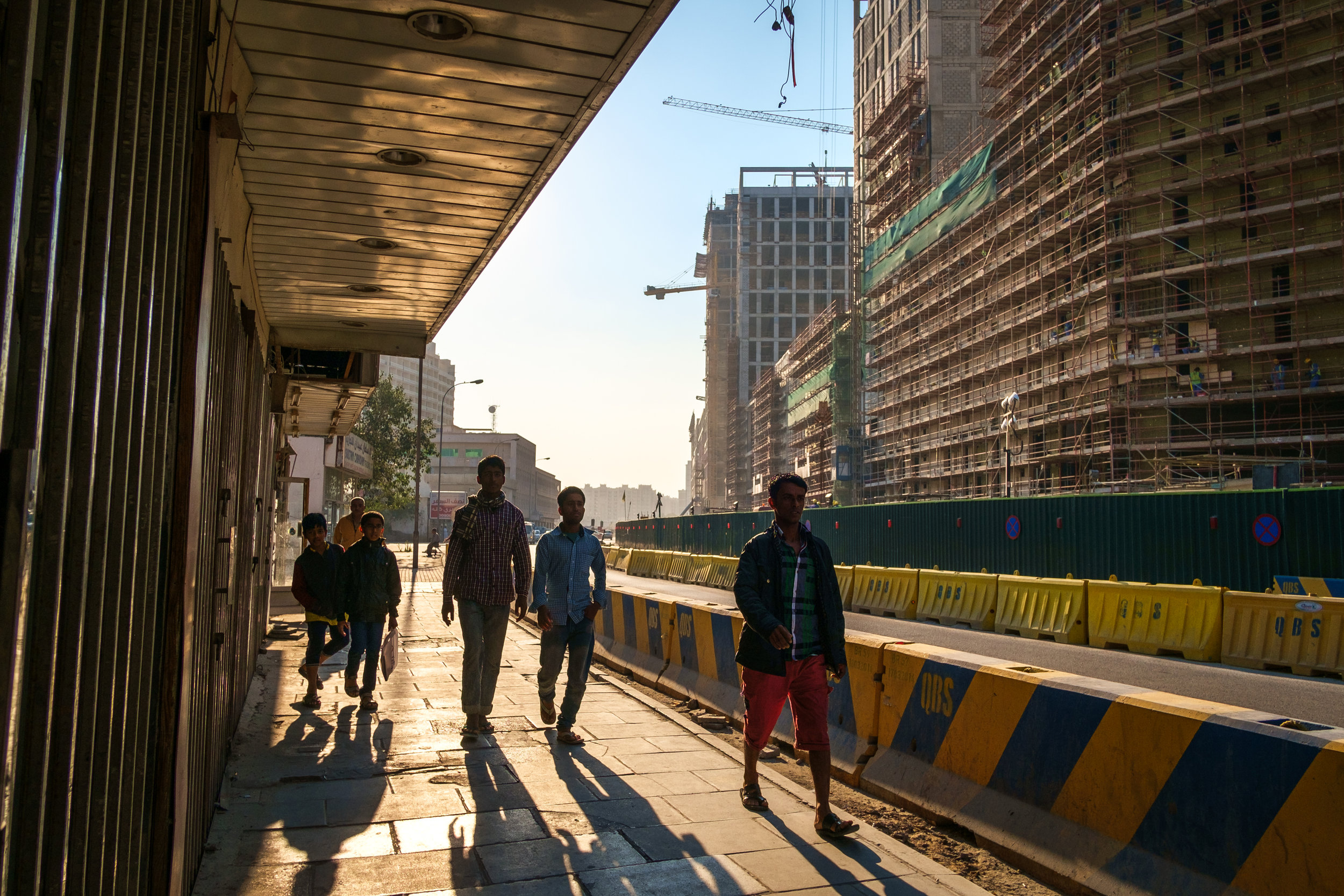 A street scene in the old Musheireb neighborhood of Doha with the new Msheireb development rising above it. Much of this old part of Doha has been torn down as Qatar races to revitalize and modernize in time to host the 2022 FIFA World Cup.