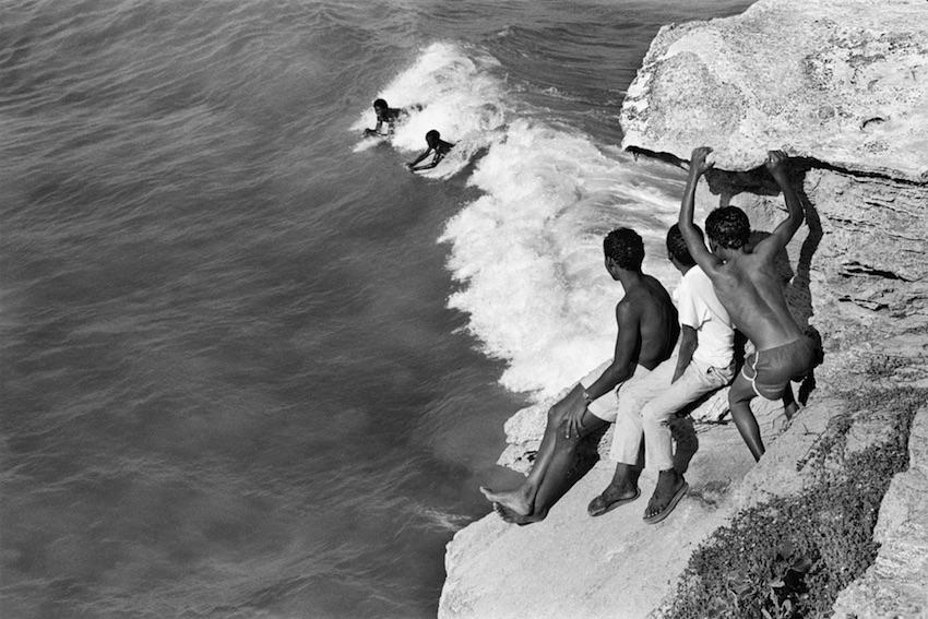 Children from Arniston or Waenhuiskrans surfing off the Western Cape coast, 1989