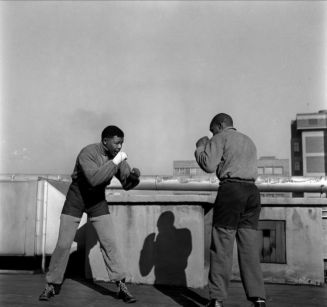 Bob Gosani, Treason Trial - end of round one - Nelson Mandela boxing on the roof top of a Newspaperbuilding in JHB, 1957, courtesy of BaileySeippel Gallery JHB, ©BAHA.jpg