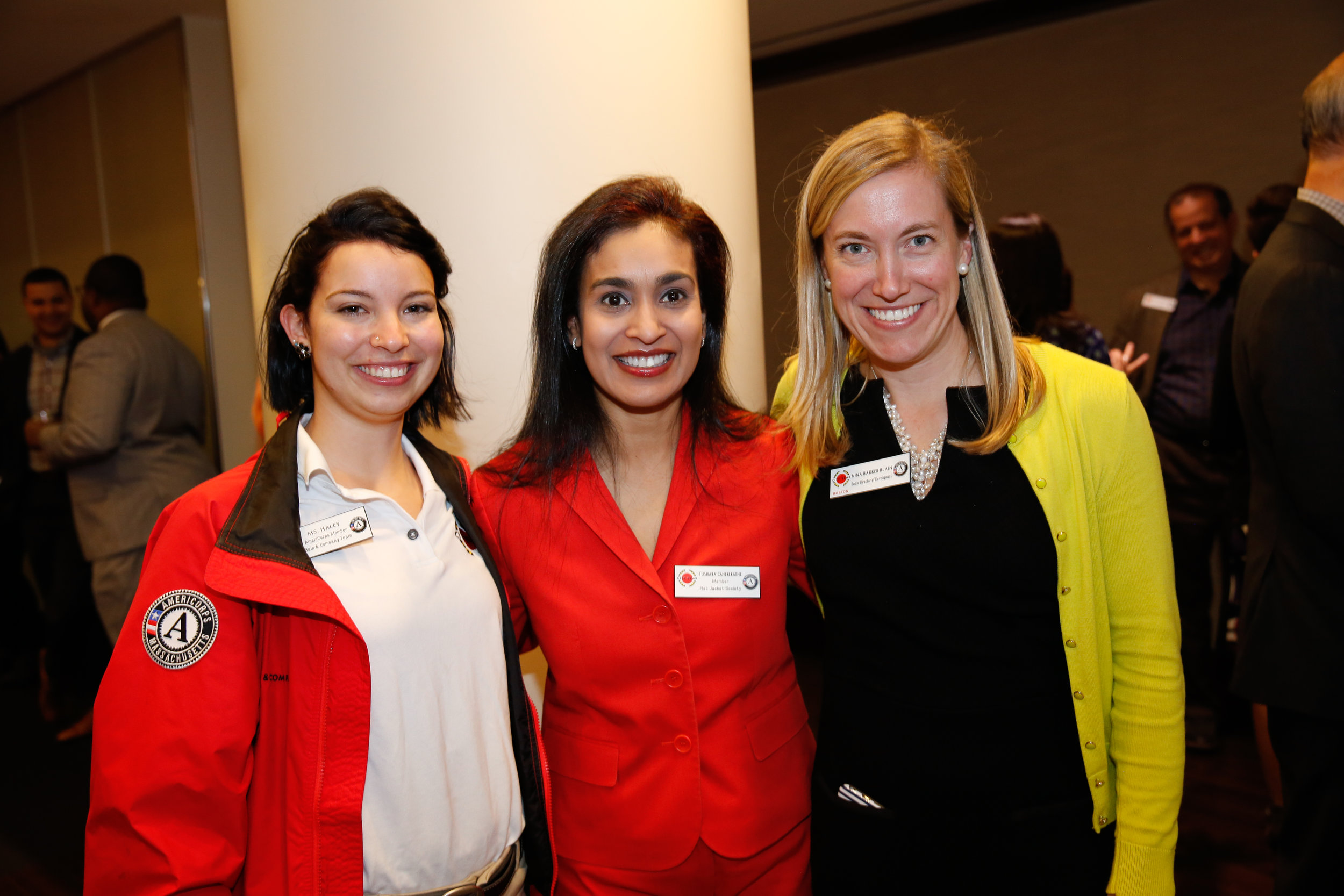 AmeriCorps member Haley Burgess, Tushara Canekeratne and Nina Barker at the Bain Capital Reception