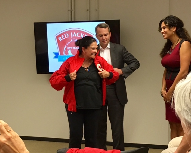 Red Jacket Society Member Laura Alter Klapman receiving her Red Jacket