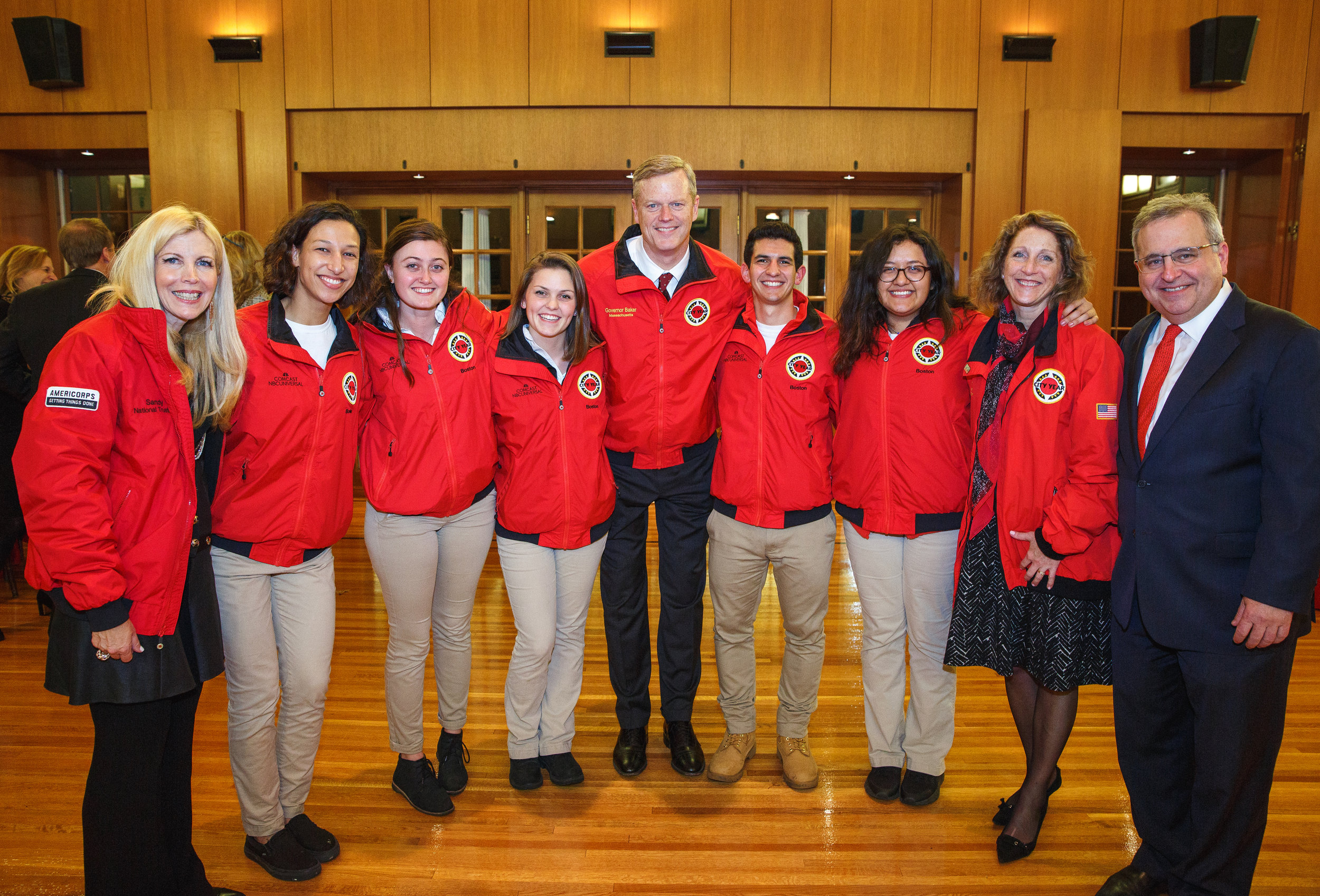 Governor Charlie Baker and his wife Lauren Baker with Sandy Edgerley, Michael Brown and City Year AmeriCorps members