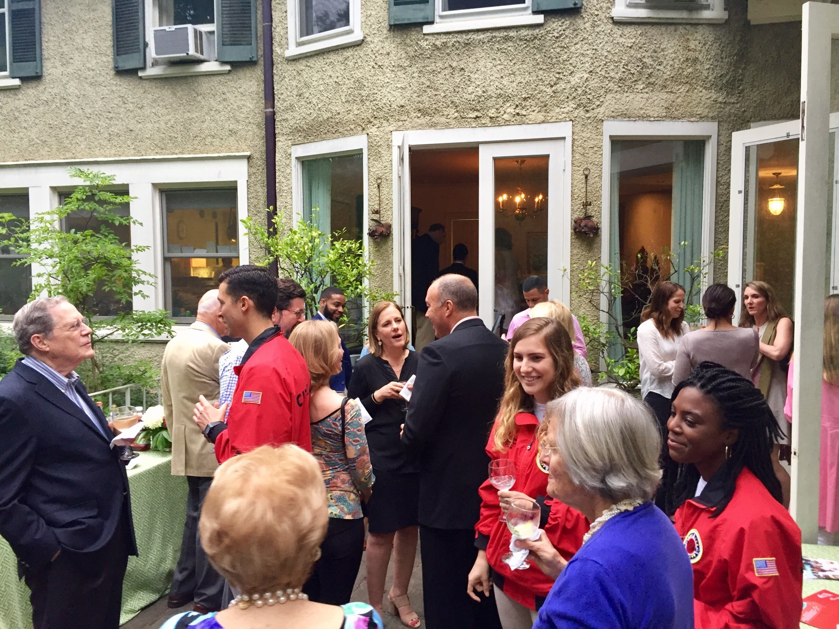 Guests and AmeriCorps members mingle during the event