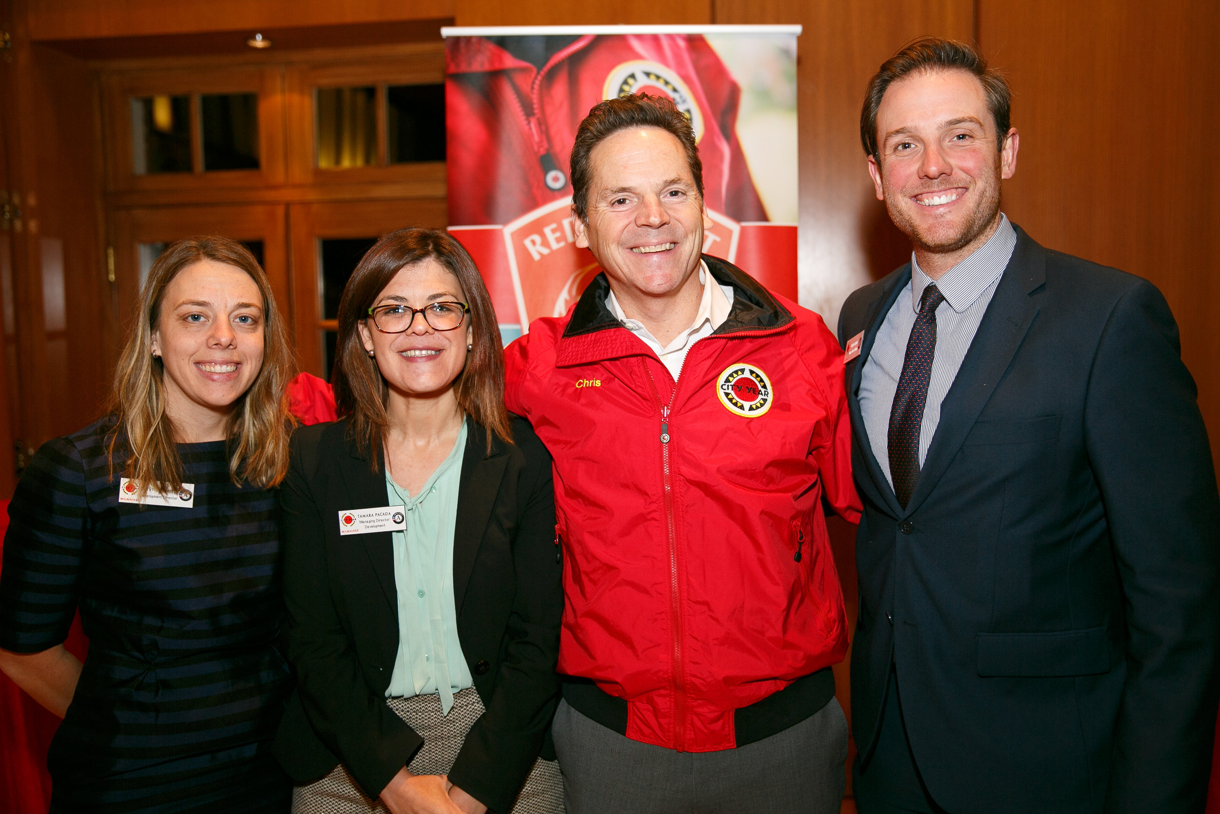 City Year Milwaukee Development Director, Betsy Mitchell; City Year Milwaukee Senior Director of Development, Tamara Pacada; City Year Milwaukee Board Co-Chair, Chris Didier; and City Year Milwaukee Major Gifts Officer, Tyler Hart at the RJS Jacket Dedication Reception