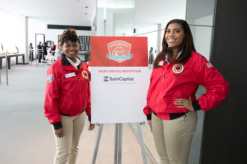 City Year Chicago AmeriCorps Members welcoming guests to the Bain Capital Red Jacket Society Private Reception