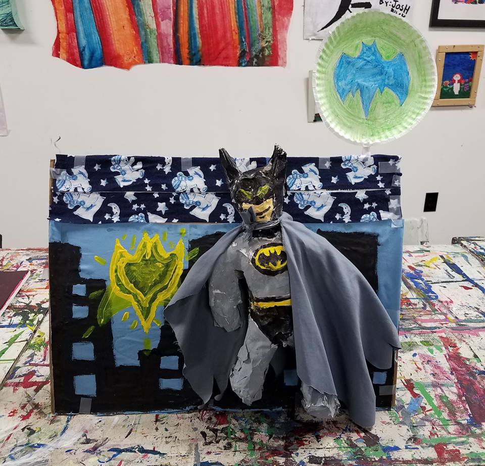 JB - JB enjoys creating 3-D art using papier mache.