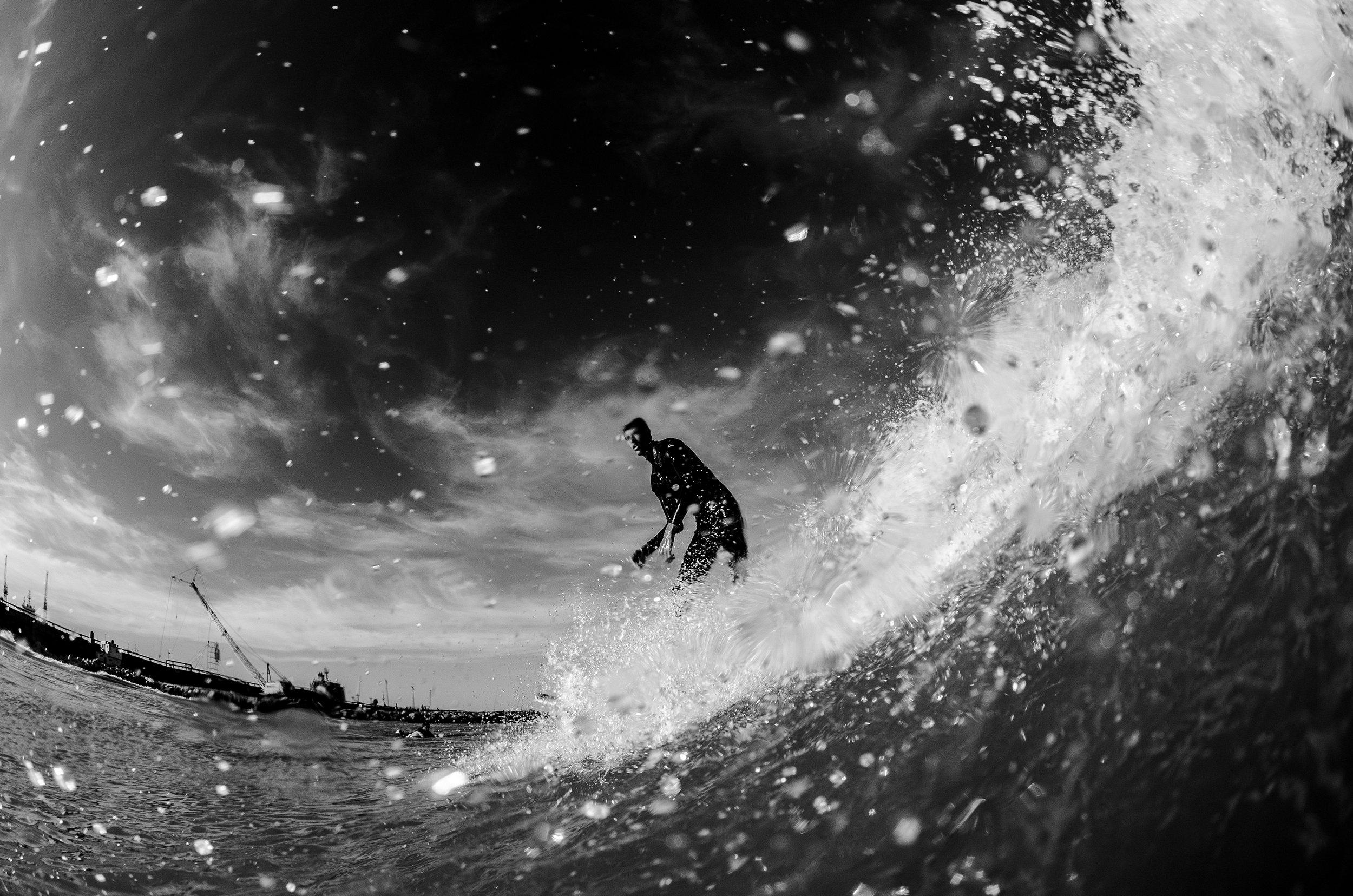 Canva - Man Surfing.jpg