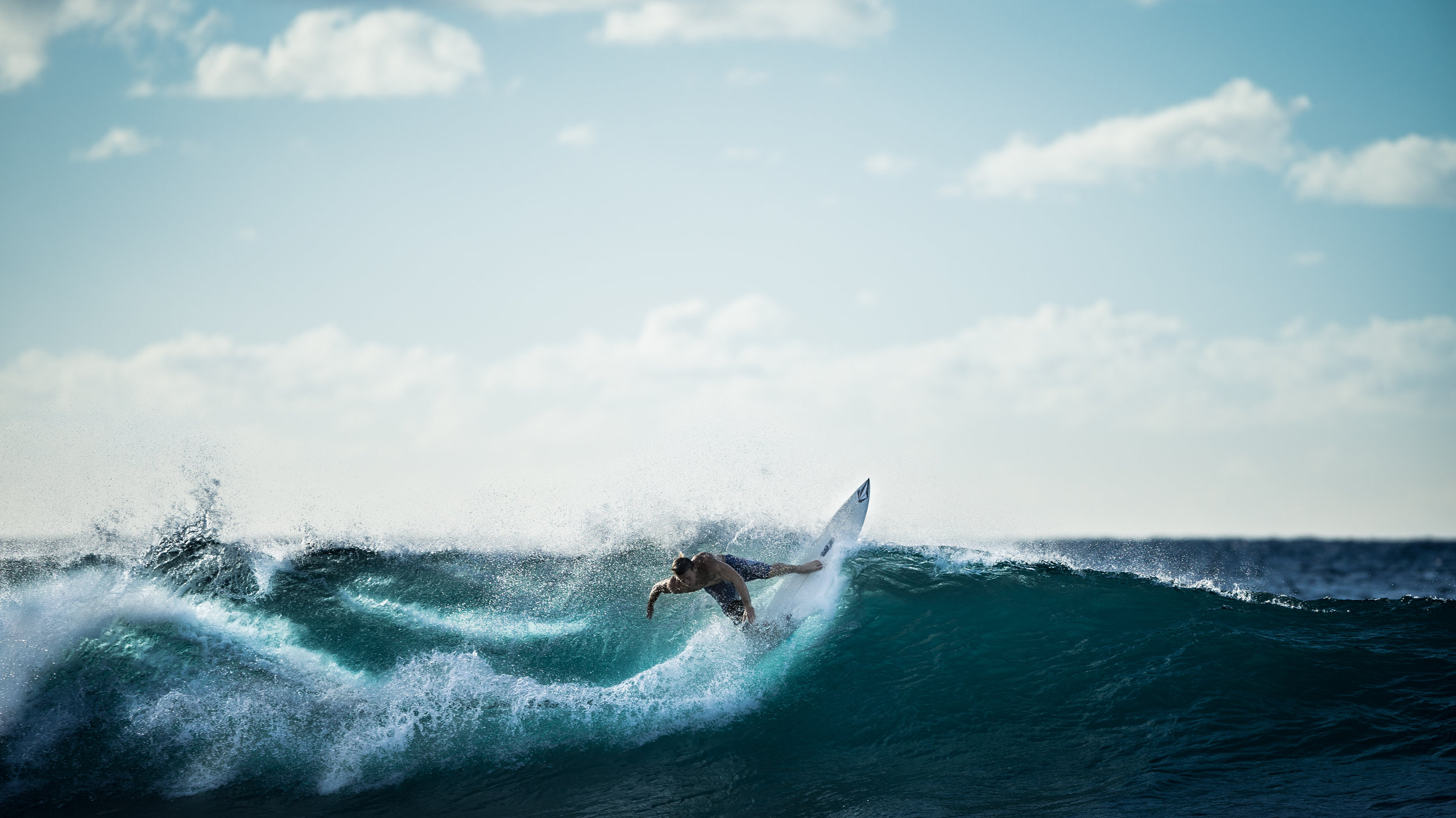 Canva - Person Riding on White Surfboard Doing Surfing.jpg
