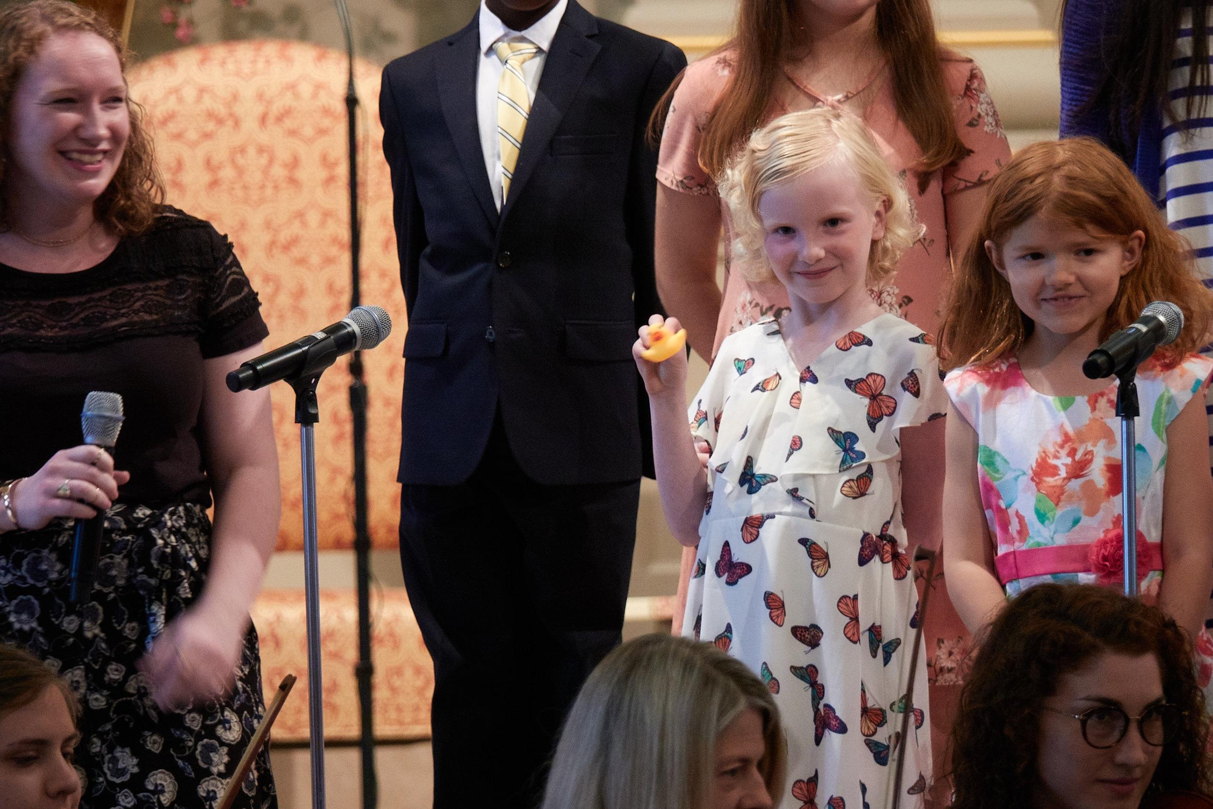 Soprano Suzie Wiedefeld sings with the children.