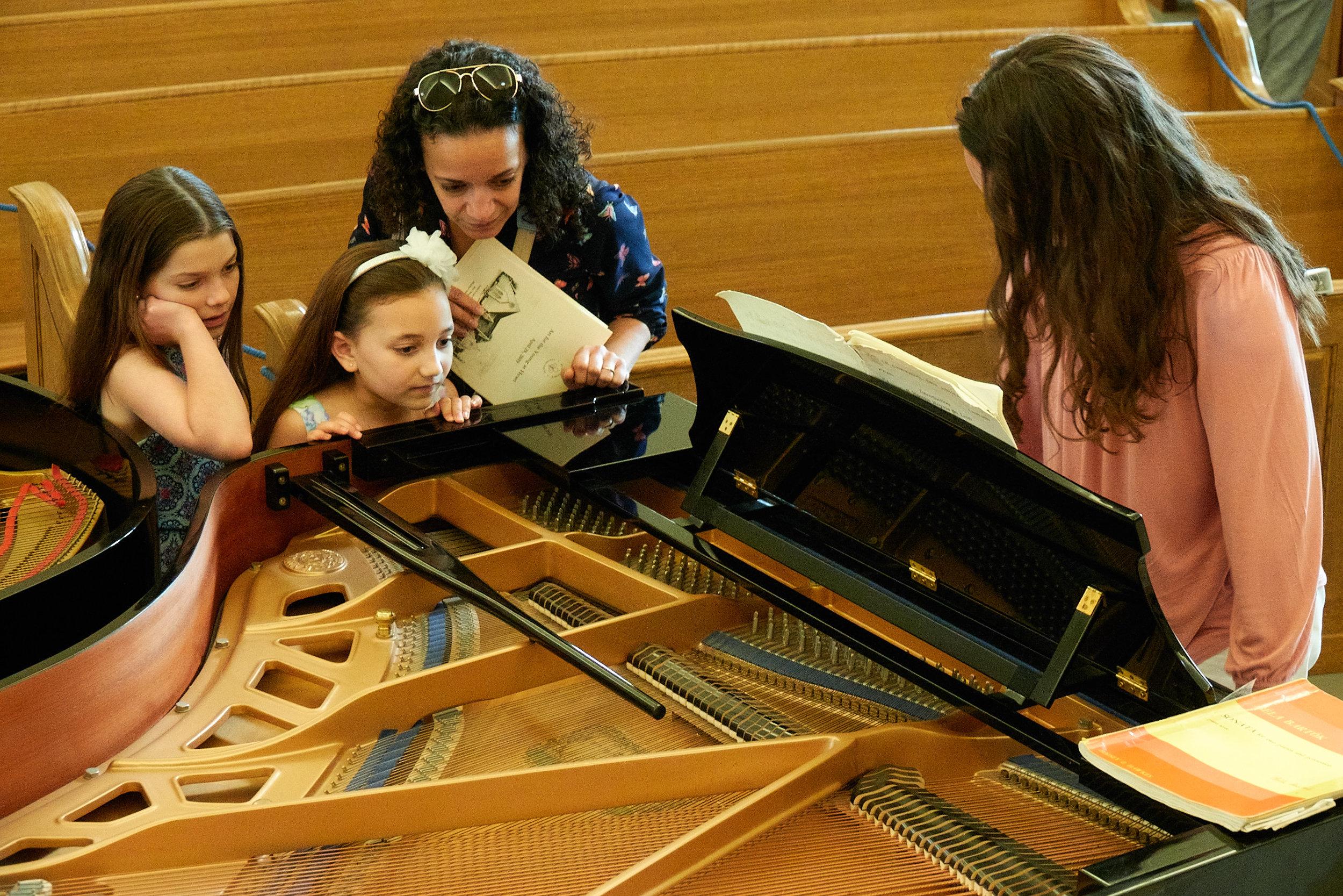 Larissa Sanders shows off a grand piano.