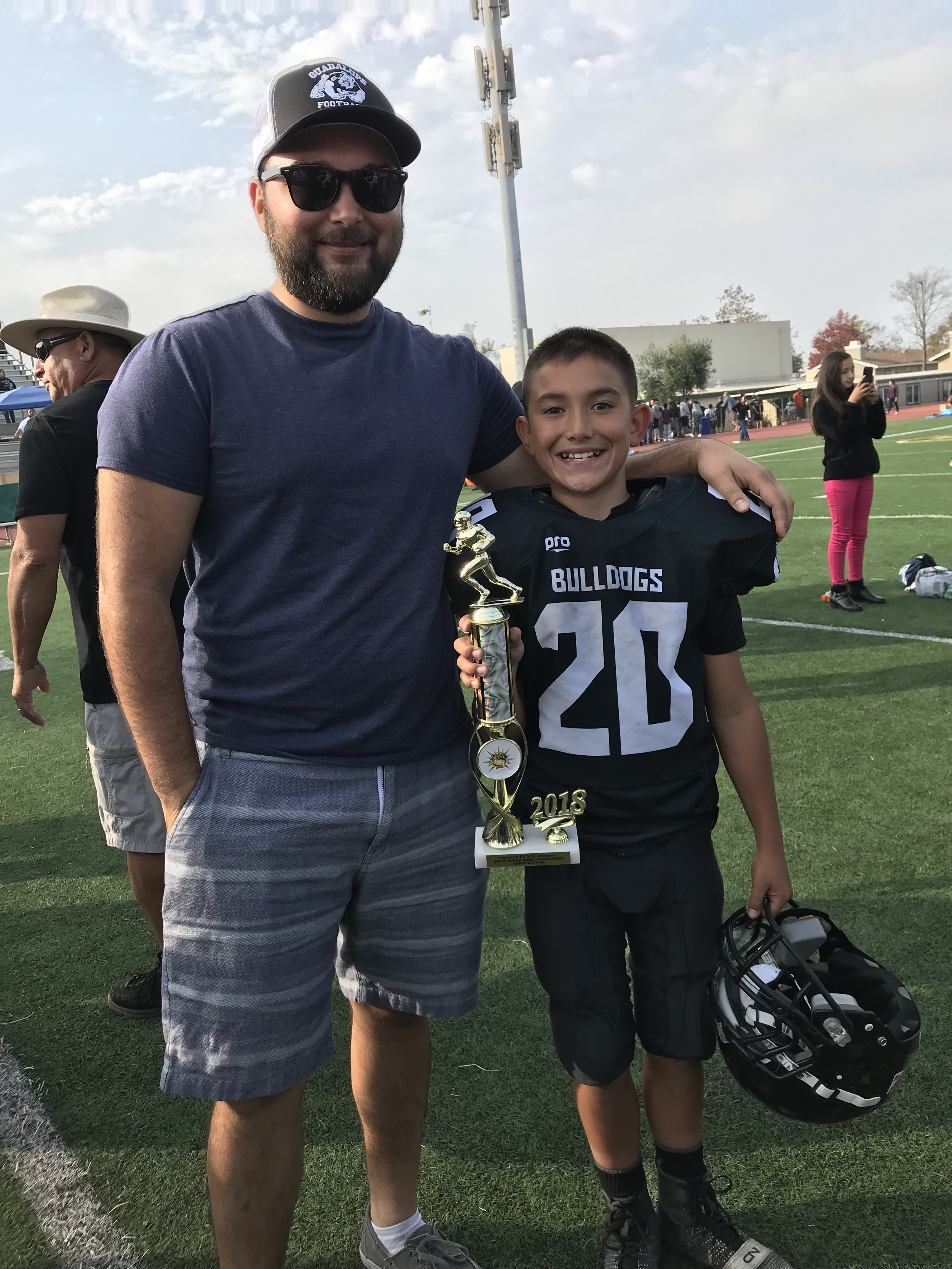 nick and his younger brother brandan after his little league superbowl win this past year