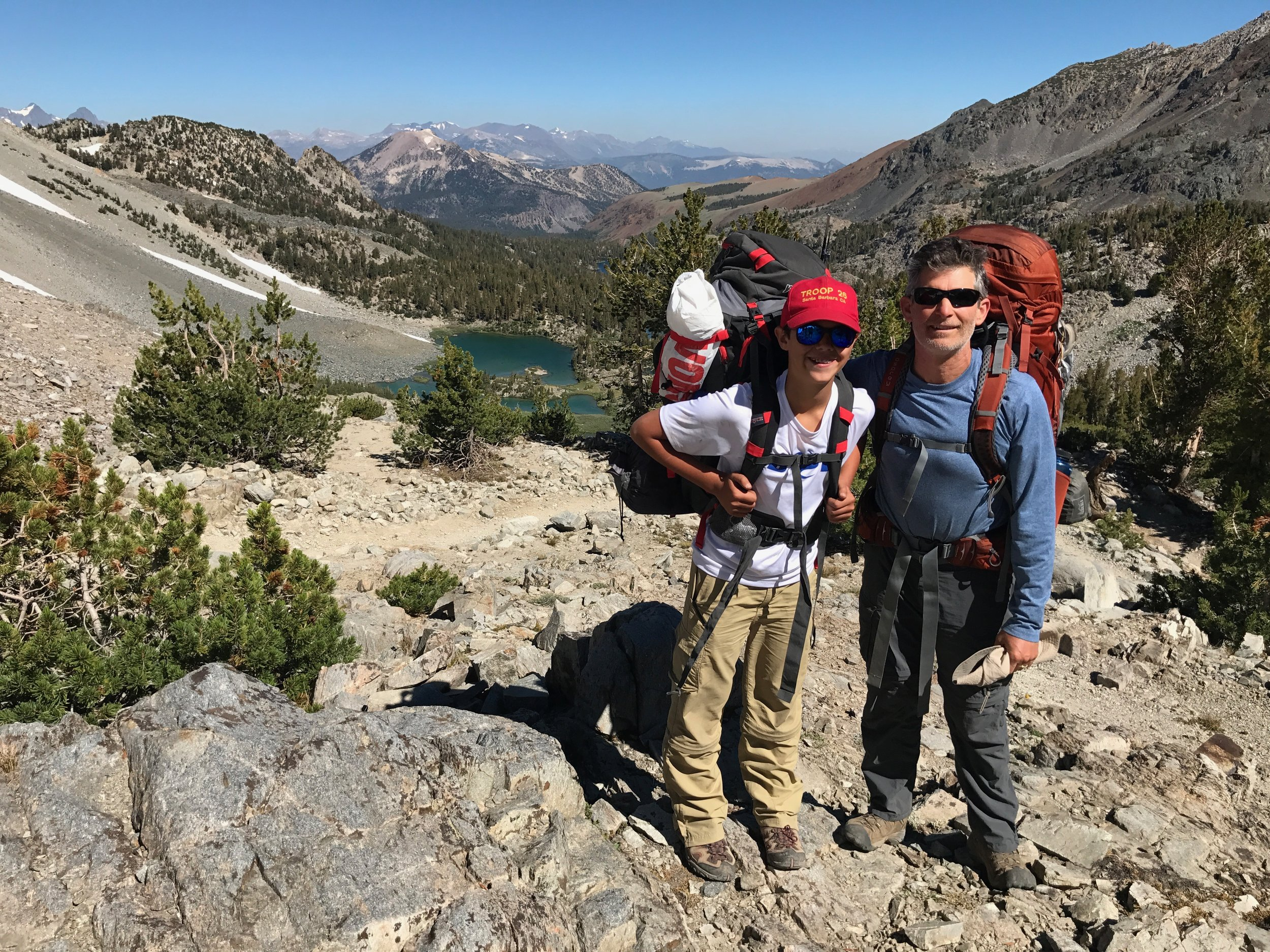 Mike backpacking in the sierras with his youngest son, nicolis.