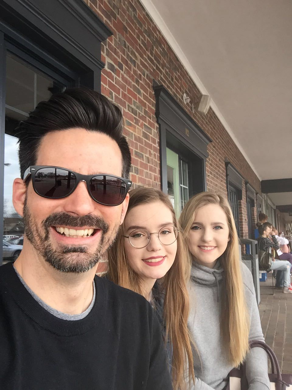 Jeremy with his daughters, isabel and alexia, waiting for a table at one of their favorite breakfast joints, first watch. they love breakfast!