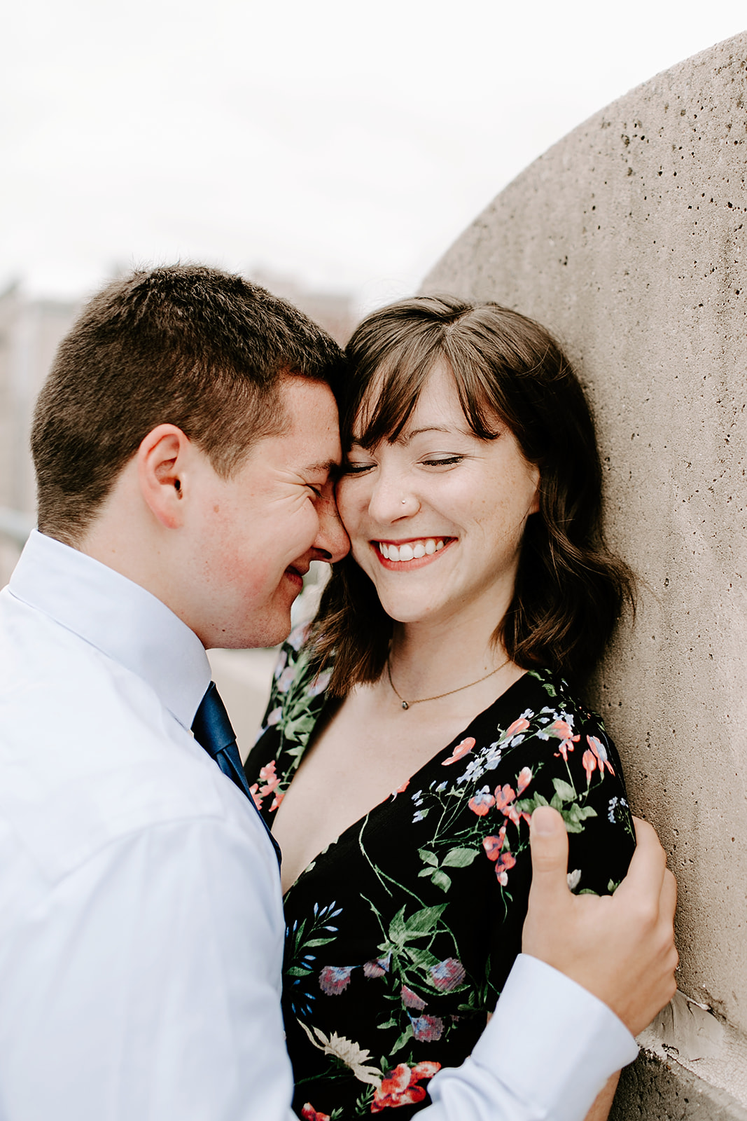 Click to browse the blog of this Downtown Indianapolis Engagement Session with Emily and Davis by Emily Wehner, Indianapolis photographer. Posing inspiration | Couples session location ideas | Urban engagement session #photography #engagementphotography #posinginspiration #urbancouplessession