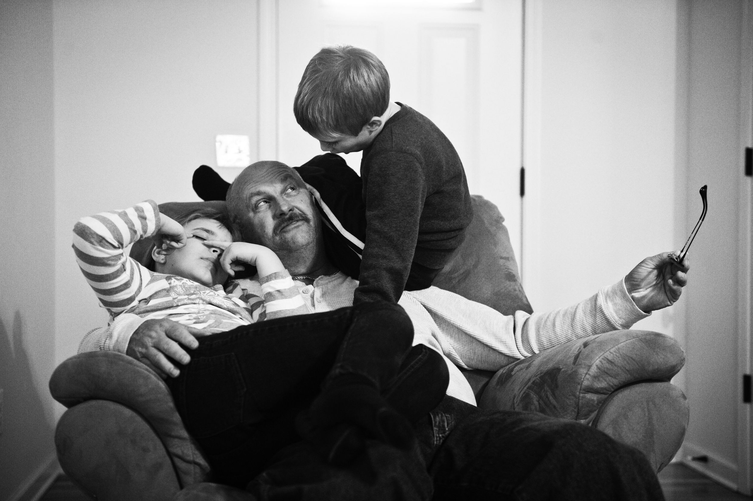 Dion Jones, playes with is grandchildren Brian and Hope Jones, 8, at their home.