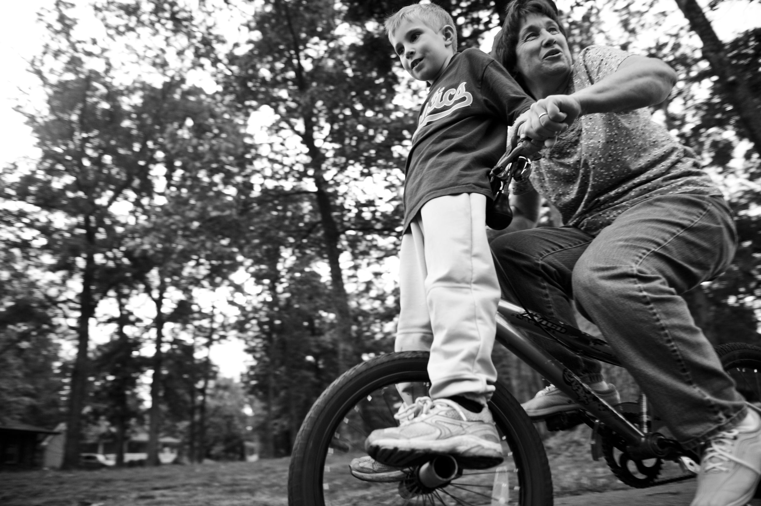 Joyce and Brian ride around on Brian's bike.