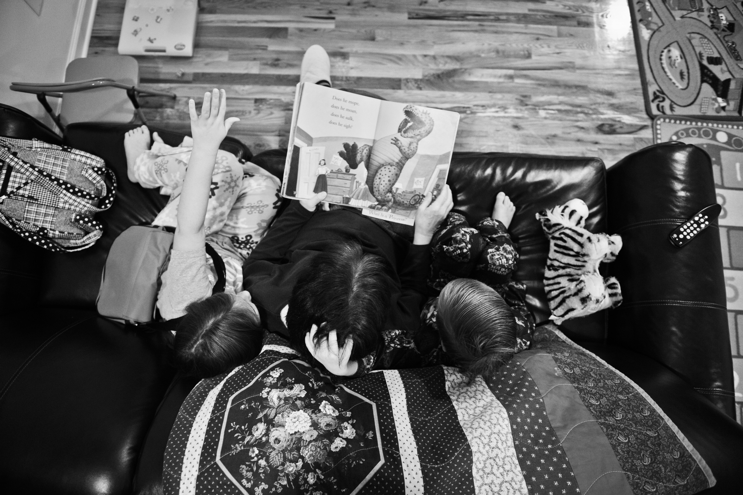 Joyce, Hope and Brianread a bedtime story at their home.