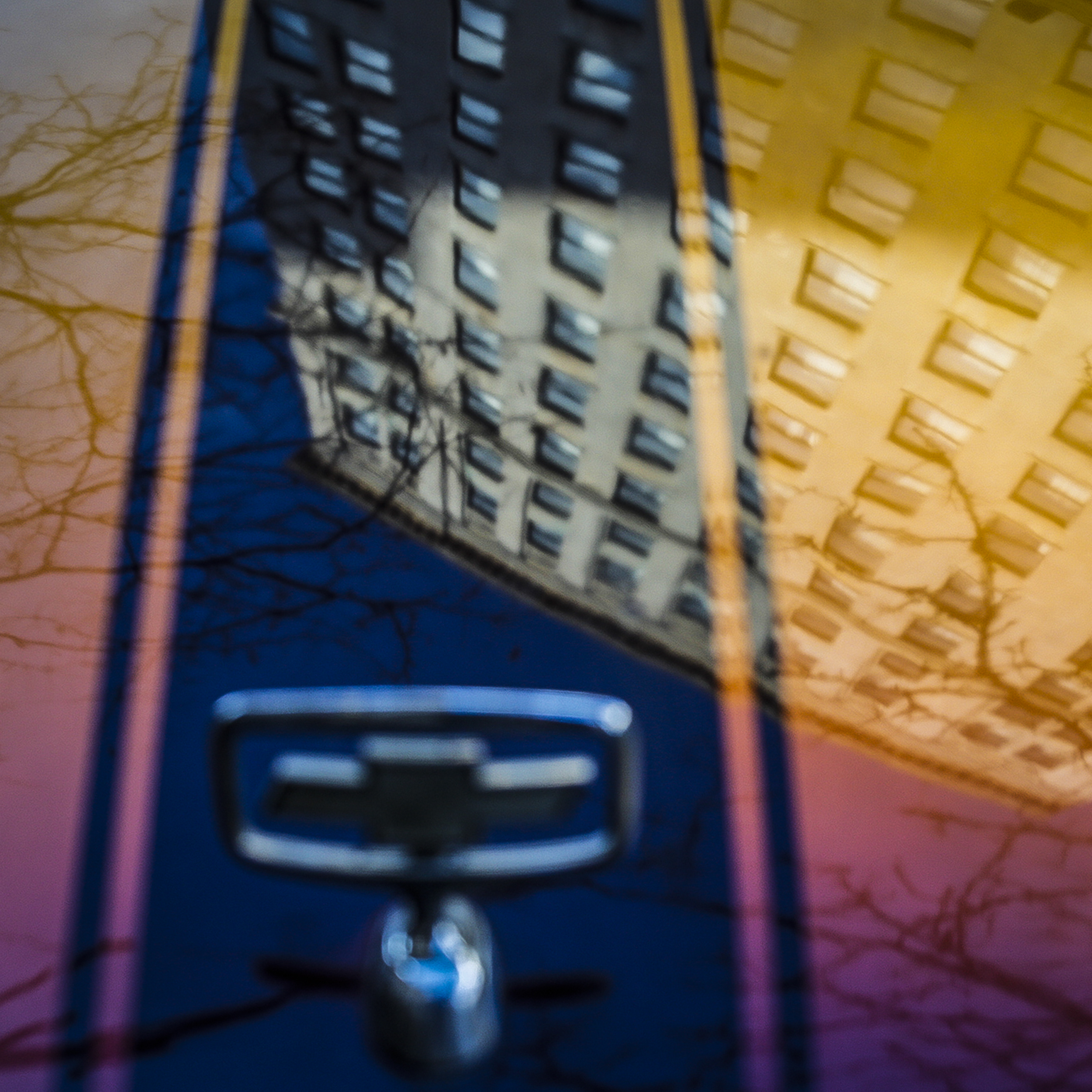 The Residence Inn is reflected in the hood of a Chevrolet which was parked along East Gay Street in downtown Columbus, Ohio on Tuesday, Nov. 19, 2013.