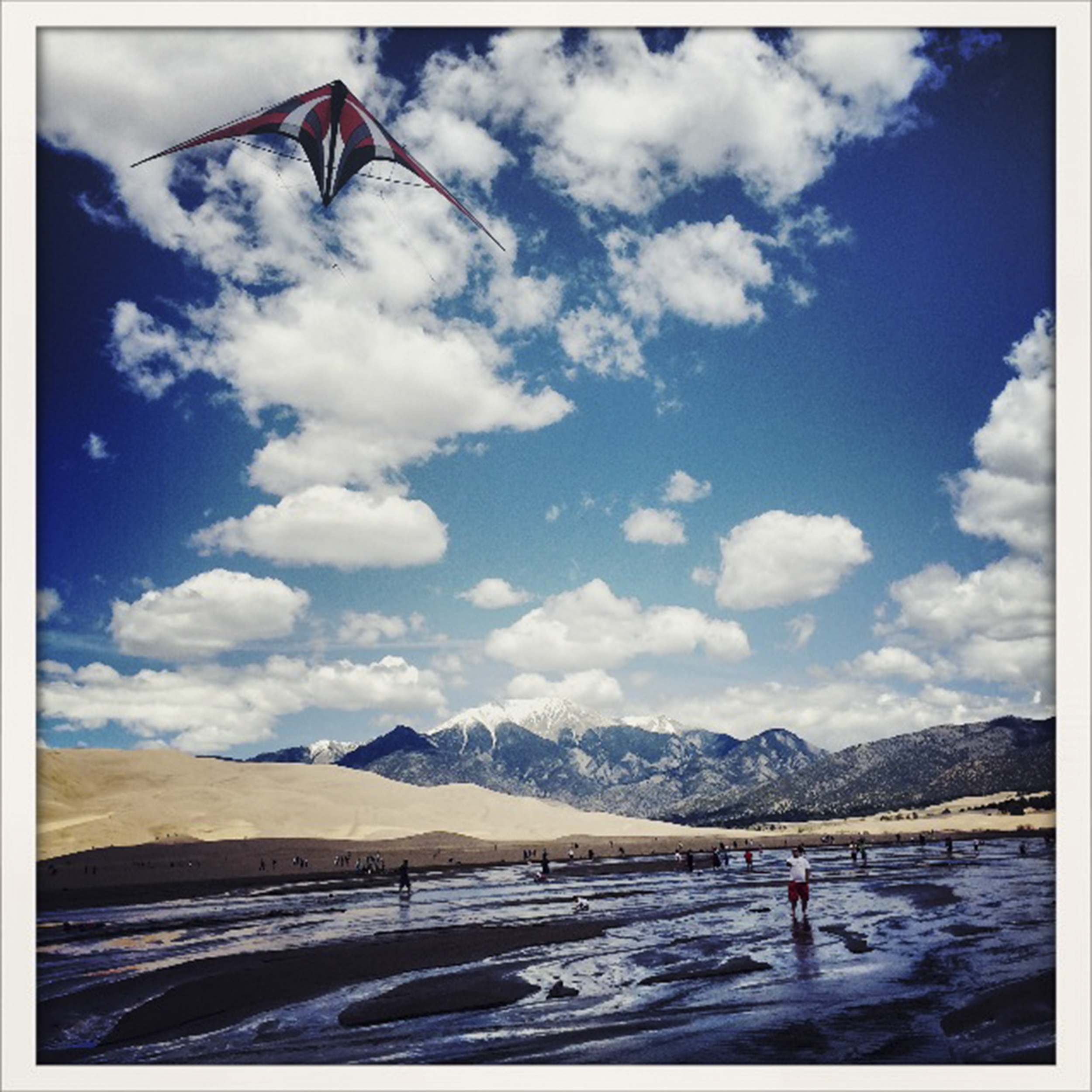 A man flys a kite at the Great Sand Dunes National Park in Mosca, Colorado on Monday May 26, 2014.