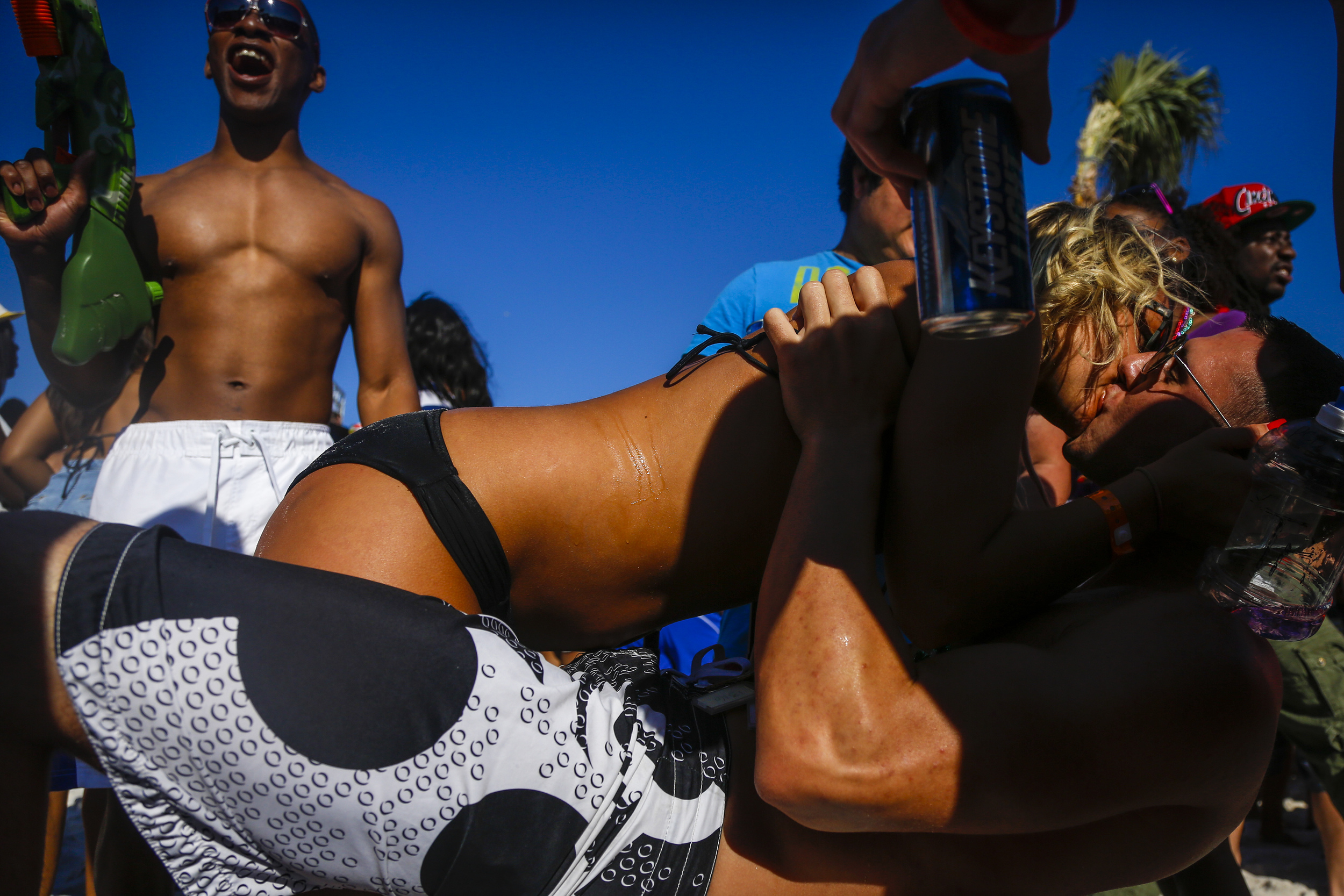 Spring breakers make out after a jello body shot as students from around the country congregate to party and have a good time in Panama City Beach, Florida.