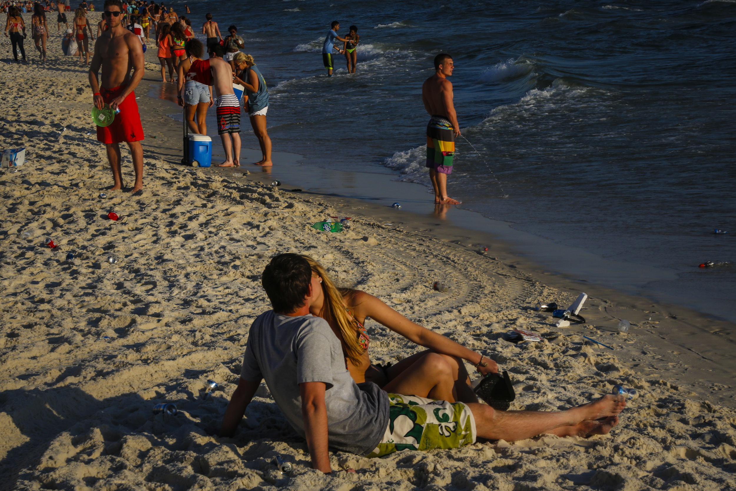 Spring breakers make out, party and urinate into the ocean.