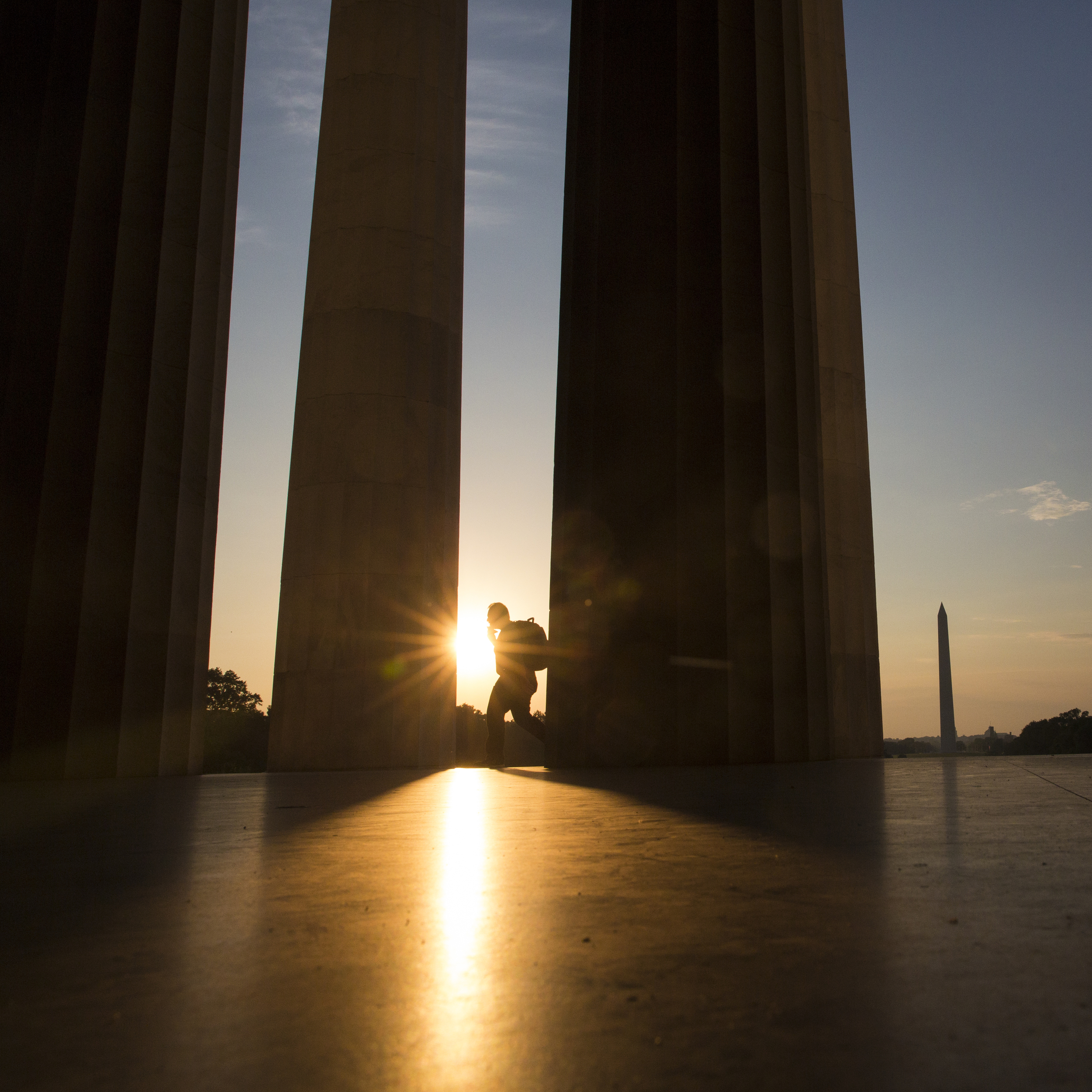 A man walks along the columns at the Lincoln Memorial on the morning of Wednesday June 4, 2014. The Lincoln Memorial is an American national monument built to honor the 16th President of the United States, Abraham Lincoln. The building is in the form of a Greek Doric temple and contains a large seated sculpture of Abraham Lincoln and inscriptions of two well-known speeches by Lincoln, The Gettysburg Address and his Second Inaugural Address.