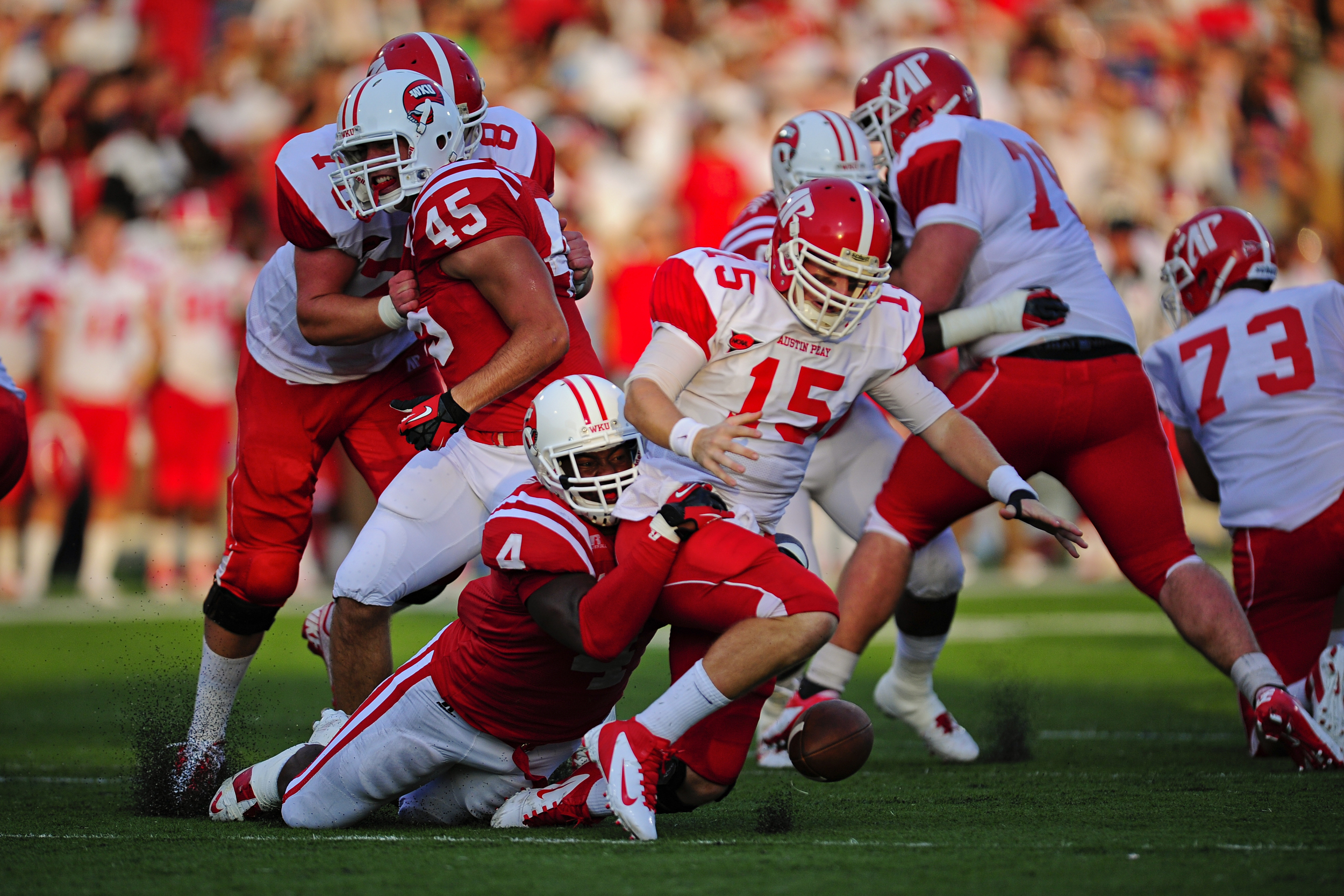 Austin Peay's senior quarter back Jake Ryan fumbles and is tackled by WKU's junior line backer Andrew Jackson during the WKU's first home football game of the 2012 season against Austin Peay Governors at L.T. Smith Stadium. WKU won 49-10.