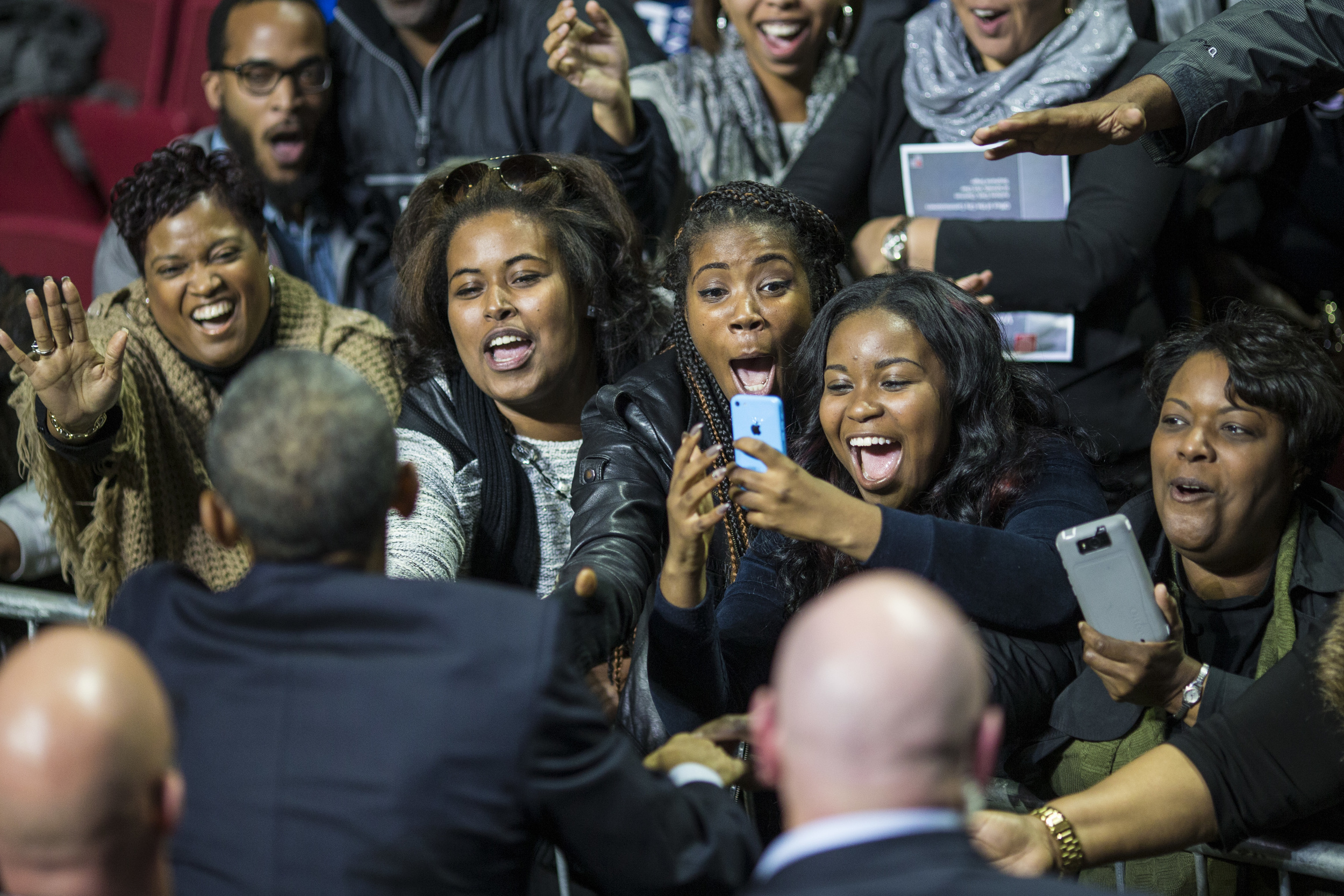 Crowds reach for and cheer for President Obama after he delivered remarks at a campaign rally for Tom Wolf at The Liacouras Center, Temple University in Philadelphia, PA on Sunday November 02, 2014.