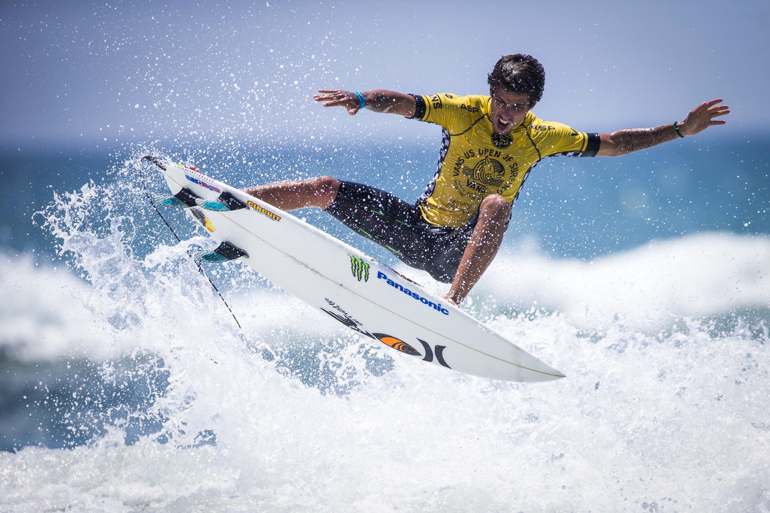 Filipe Toledo competes during the 6th heat of the 3rd round of the mens surfing main event during the 6th day of the Vans US Open at the Huntington Beach Pier in Huntington Beach on Thursday July 31, 2014.