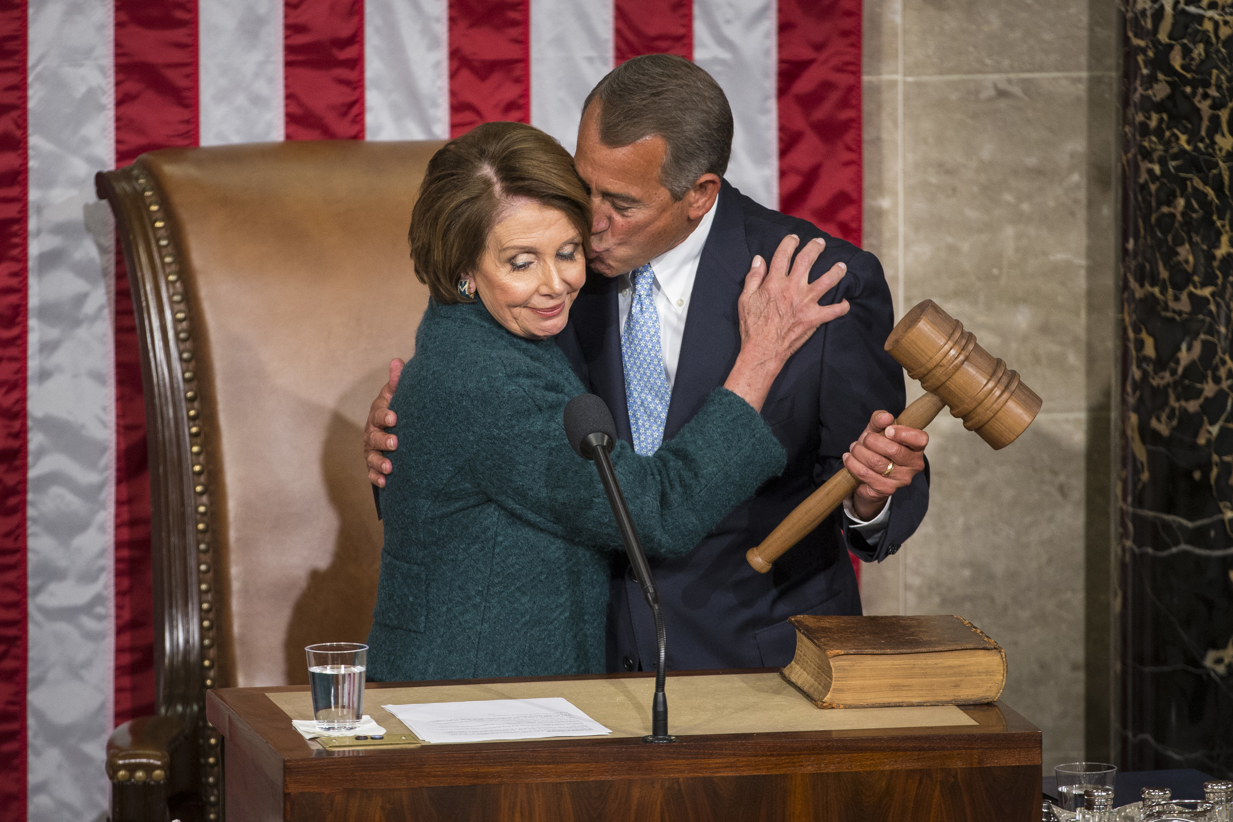 House Speaker John Boehner of Ohio, kisses House Minority Leader Nancy Pelosi of Calif. after being re-elected to a third term during the opening session of the 114th Congress, as Republicans assume full control for the first time in eight years on Capitol Hill in Washington, DC on Friday January 06, 2015.