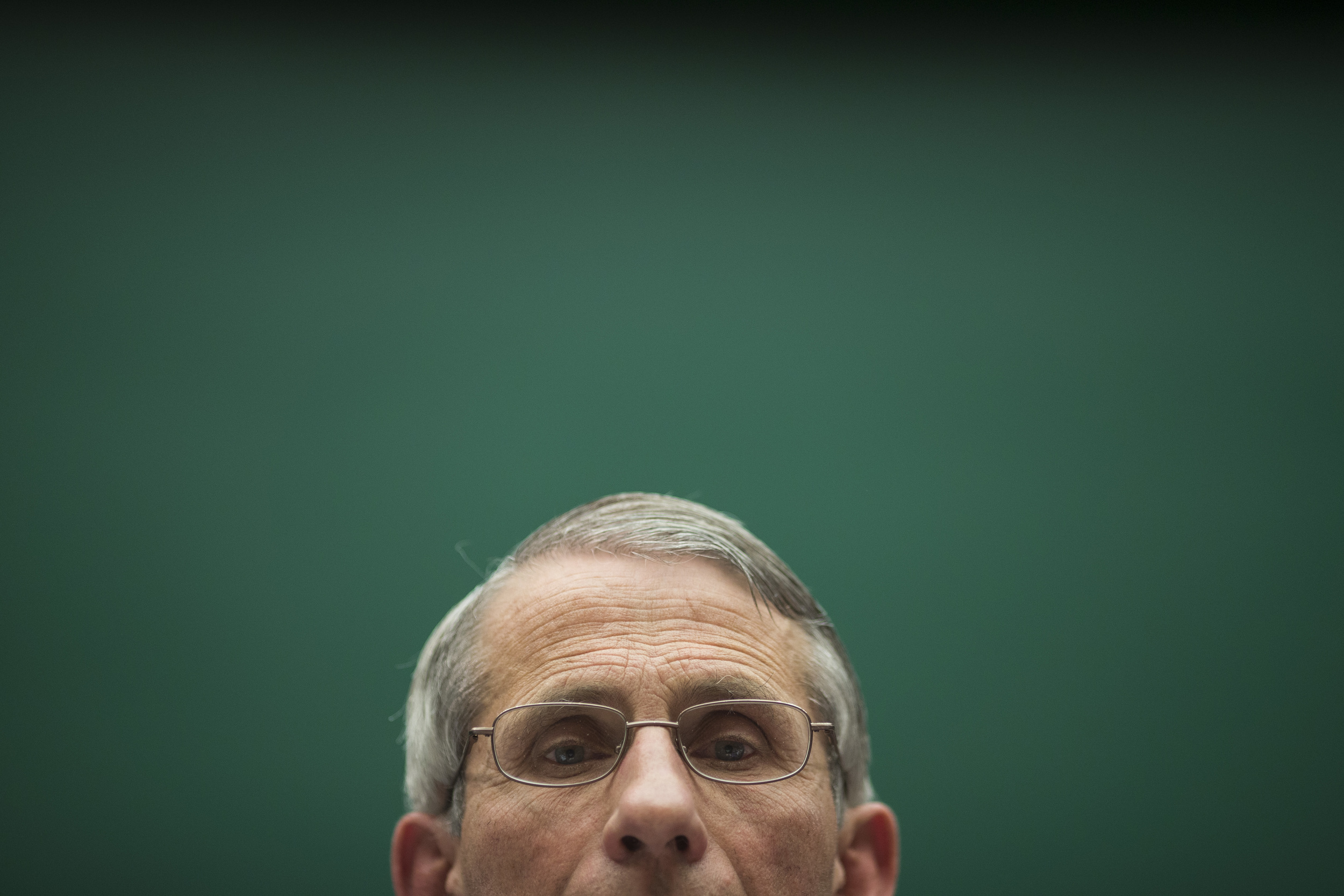 Dr. Anthony Fauci, director of The National Institute of Allergy and Infectious Diseases listens as lawmakers return to Capitol Hill to get answers about the Ebola outbreak from top U.S. health officials at the White House in Washington, DC. on Thursday October 16, 2014. The House Energy and Commerce Committee's Subcommittee on Oversight and Investigations holds a hearing to examine the government's response to contain the disease and whether America's hospitals and health care workers are adequately prepared for Ebola patients.