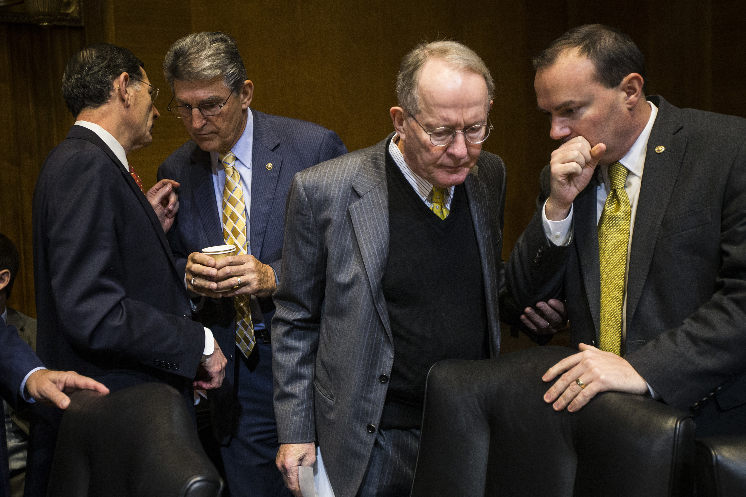 From left, Sen. John Barrasso, R-Wyo., Sen. Joe Manchin, D-W.Va., Sen. Lamar Alexander, R-Tenn., and Sen. Mike Lee, R-Utah, speak to each other during the Senate Energy and Natural Resources Committee markup on the Keystone XL pipeline bill on Capitol Hill in Washington, DC on Thursday January 08, 2015. As promised by Republican leaders who now hold the majority in Congress, the Keystone bill is at the top of their agenda after it fell short of passage in December when Democrats ruled the Senate.