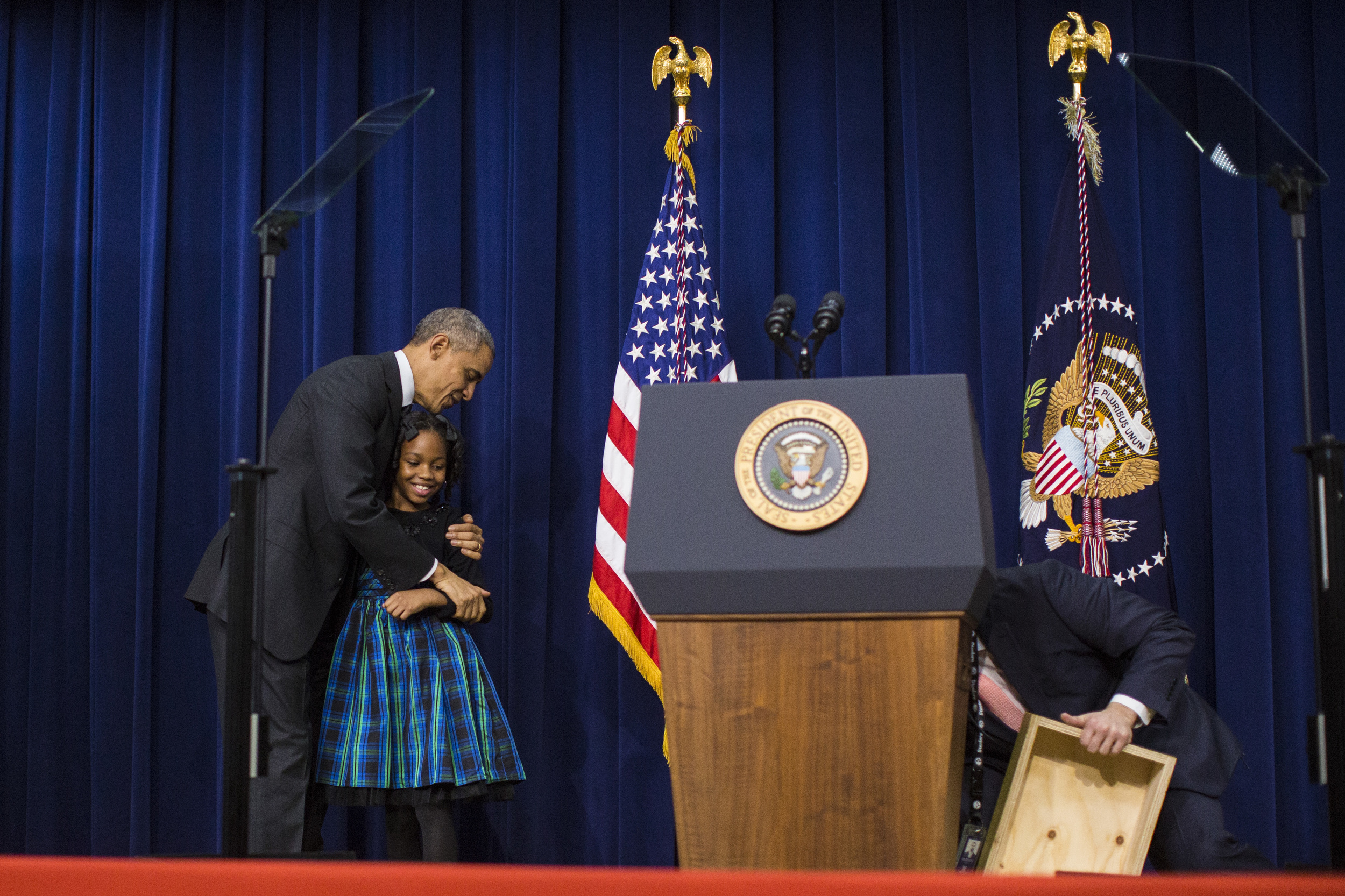 President Barack Obama hugs Alajah Lane, 9, who introduced him, before he speaks to announce new efforts to enhance and expand the reach of high-quality public preschool programs in high-need communities as well as highlight new actions by the private, philanthropic, and public sectors to invest in and expand access to high-quality early learning opportunities in communities across the country at the White House Summit on Early Education in the South Court Auditorium of the Eisenhower Executive Office Building on the White House complex in Washington, DC on Wednesday December 10, 2014. The White House Summit on Early Education is a convening of prominent business leaders, philanthropists, advocates, elected officials and members of the public committed to the expansion of  high-quality early education opportunities for children across the country from birth through school entry.