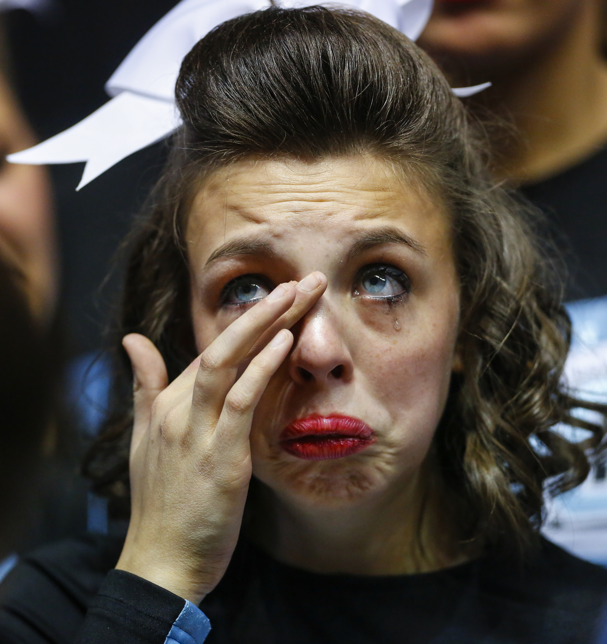 Maggie Kleine-Kracht, a Senior cheerleader from Mercy Academy cheerleading team, cries along with her teammates after receiving second place in class 1A-Large at the Kentucky High School Athletic Association's  Competitive Cheer Championships on Saturday, Feb. 23, 2013 at E.A. Diddle Arena is Bowling Green, Ky.